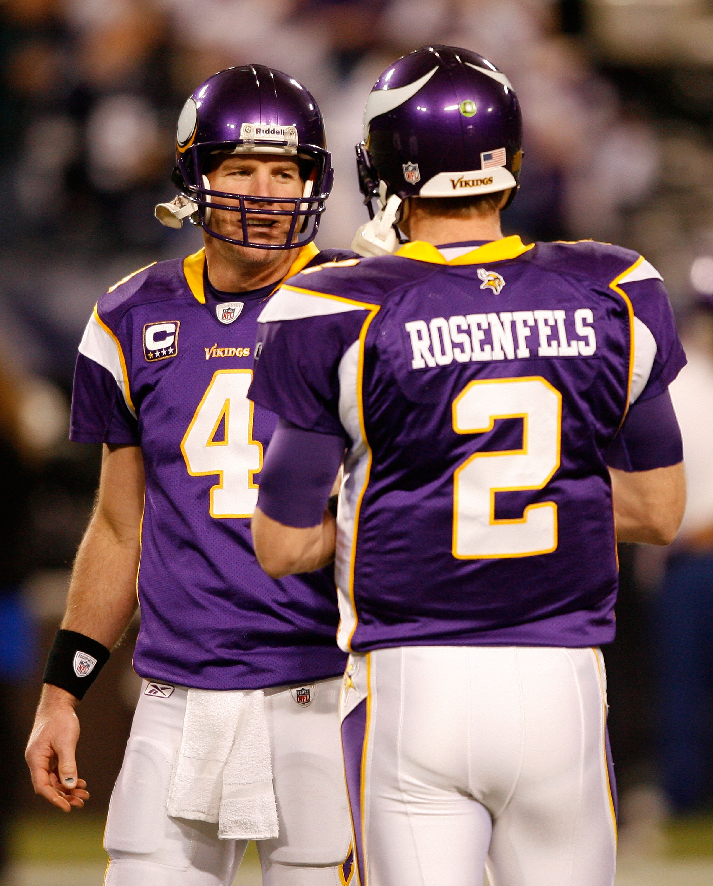MINNEAPOLIS - JANUARY 17:  Quarterback Brett Favre #4 of the Minnesota Vikings talks with quarterback Sage Rosenfels #2 before the game against the Dallas Cowboys during the NFC Divisional Playoff Game at Hubert H. Humphrey Metrodome on January 17, 2010 i