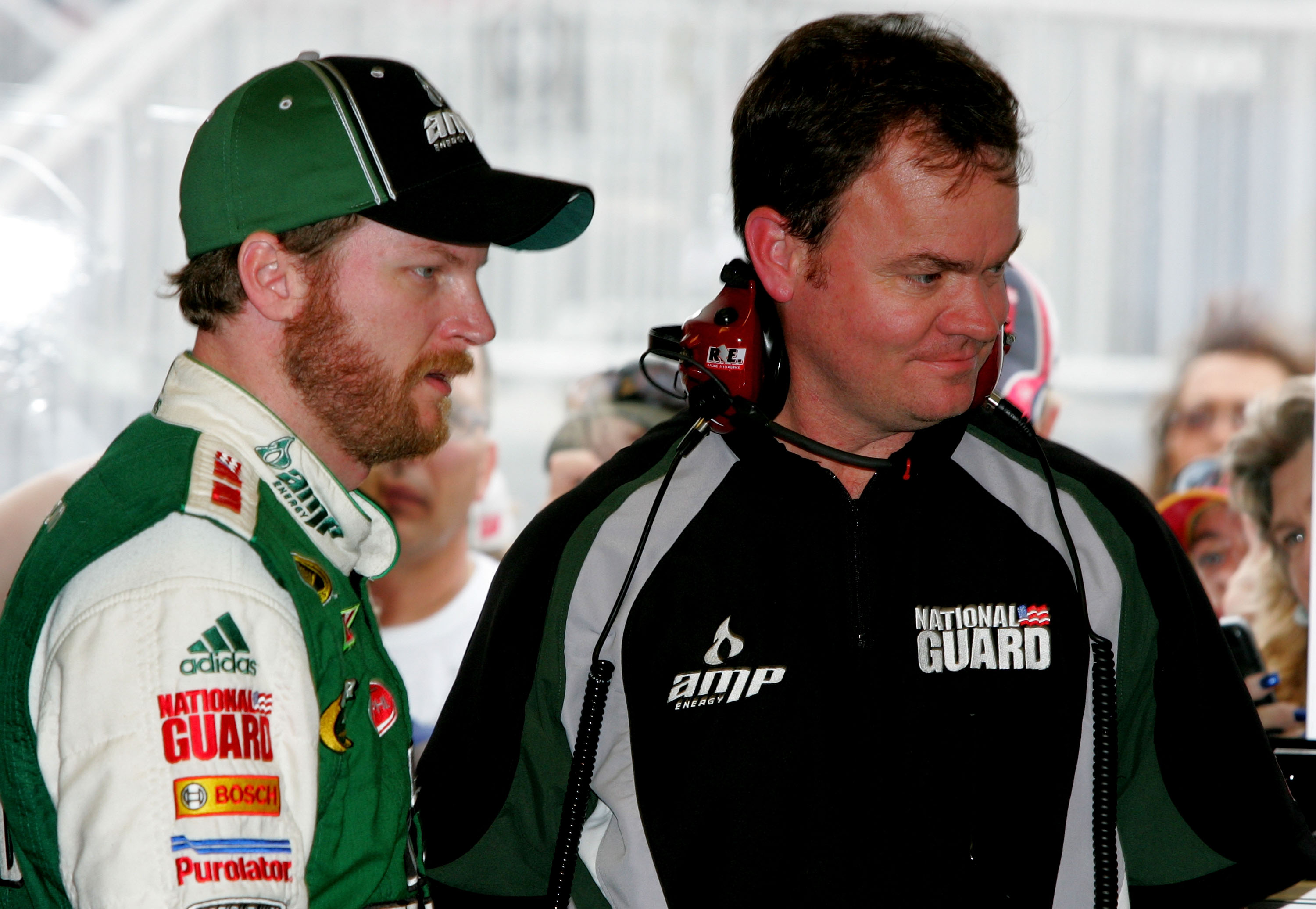DAYTONA BEACH, FL - FEBRUARY 05:  Dale Earnhardt Jr., driver of the #88 AMP Energy Chevrolet, stands in the garage with crew chief Lance McGrew during practice for the NASCAR Sprint Cup Series Daytona 500 at Daytona International Speedway on February 5, 2
