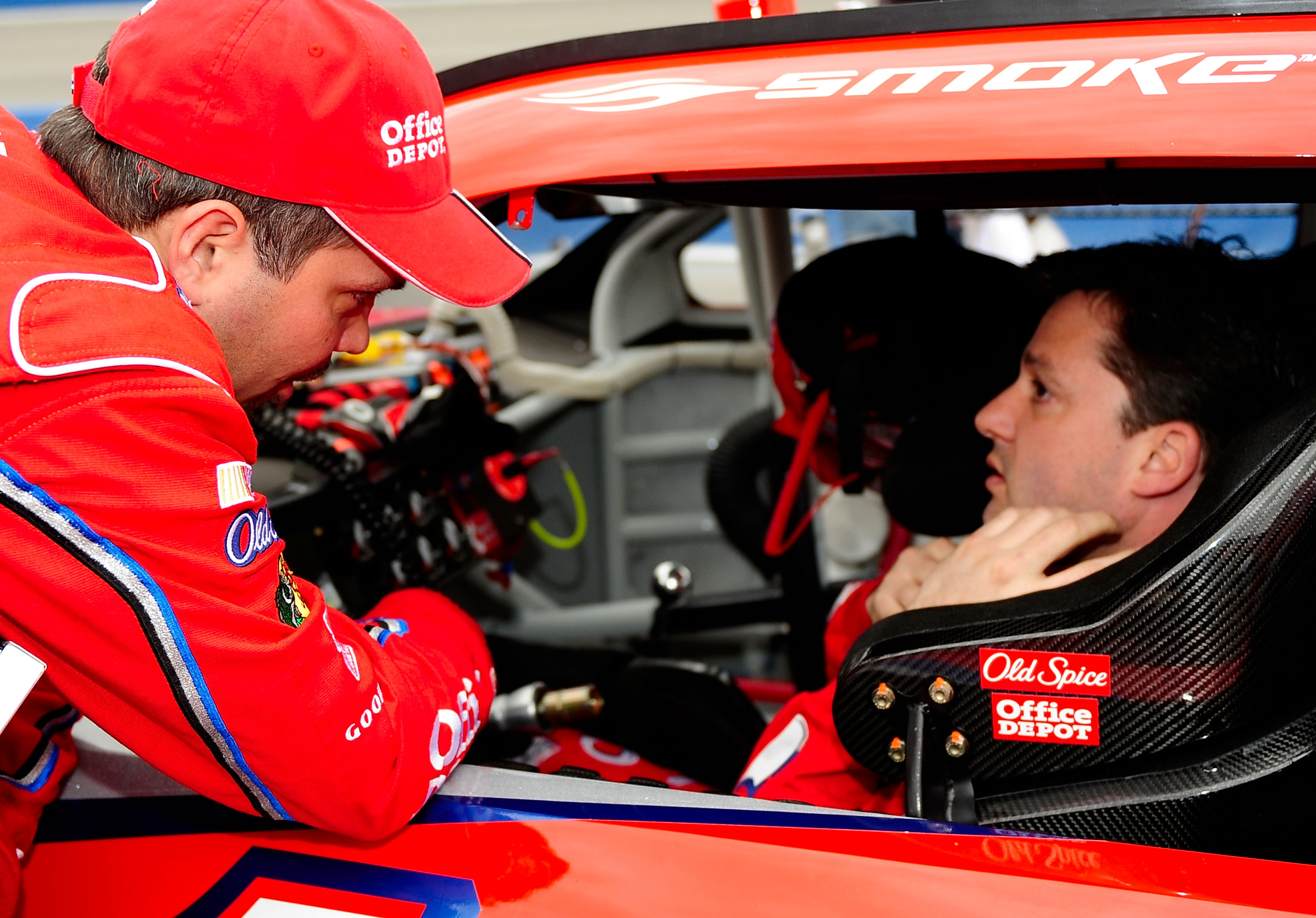 FONTANA, CA - FEBRUARY 22:  Crew chief Darian Grubb speaks with his driver Tony Stewart, driver of the #14 Old Spice/Office Depot Chevrolet on pit road prior to the start of the NASCAR Sprint Cup Series Auto Club 500 at Auto Club Speedway on February 22,