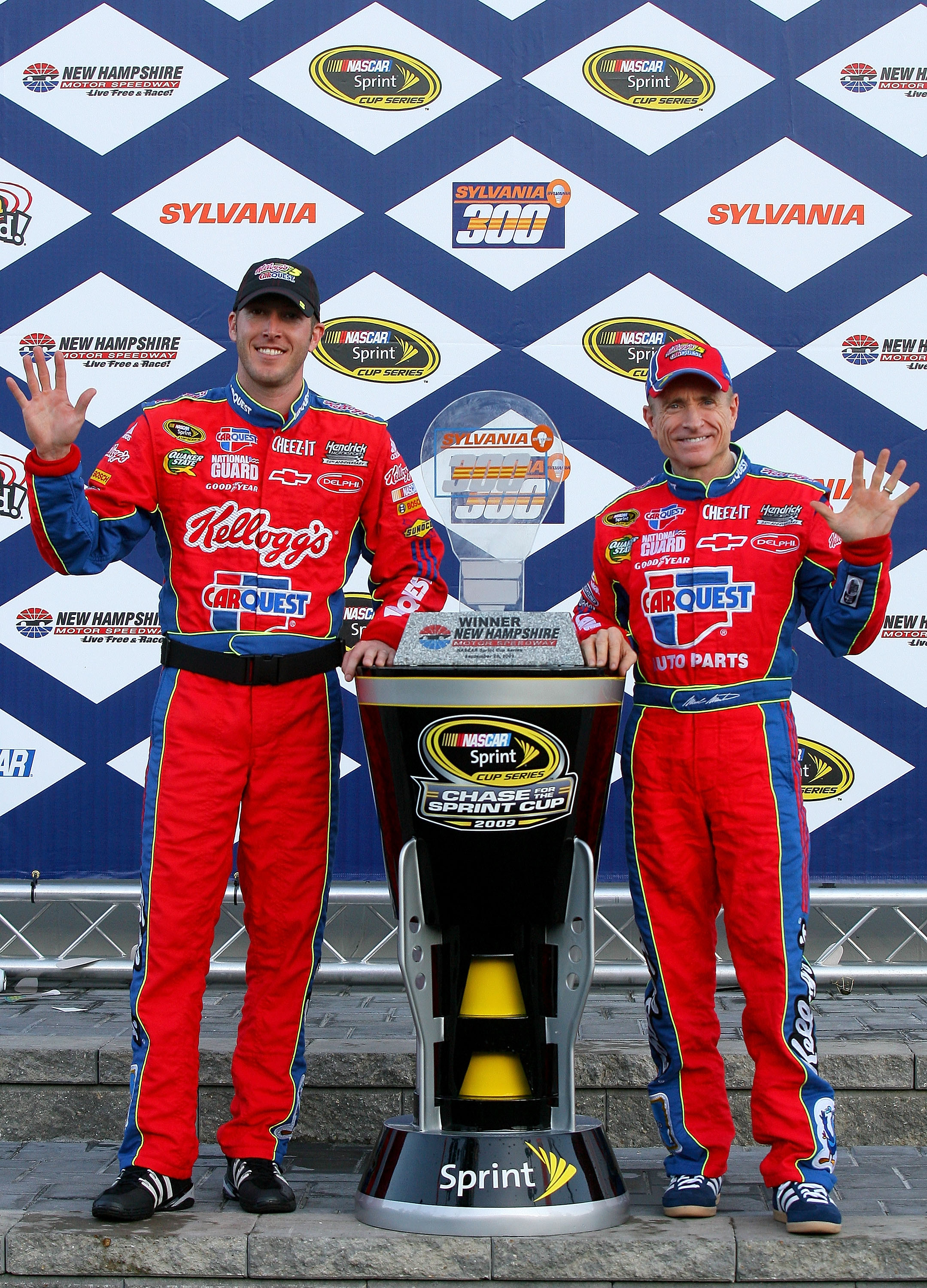 LOUDON, NH - SEPTEMBER 20:  Mark Martin (R), driver of the #5 CARQUEST/Kellogg's Chevrolet, and crew chief Alan Gustafson celebrates with the trophy in victory lane after winning the NASCAR Sprint Cup Series Sylvania 300 at the New Hampshire Motor Speedwa