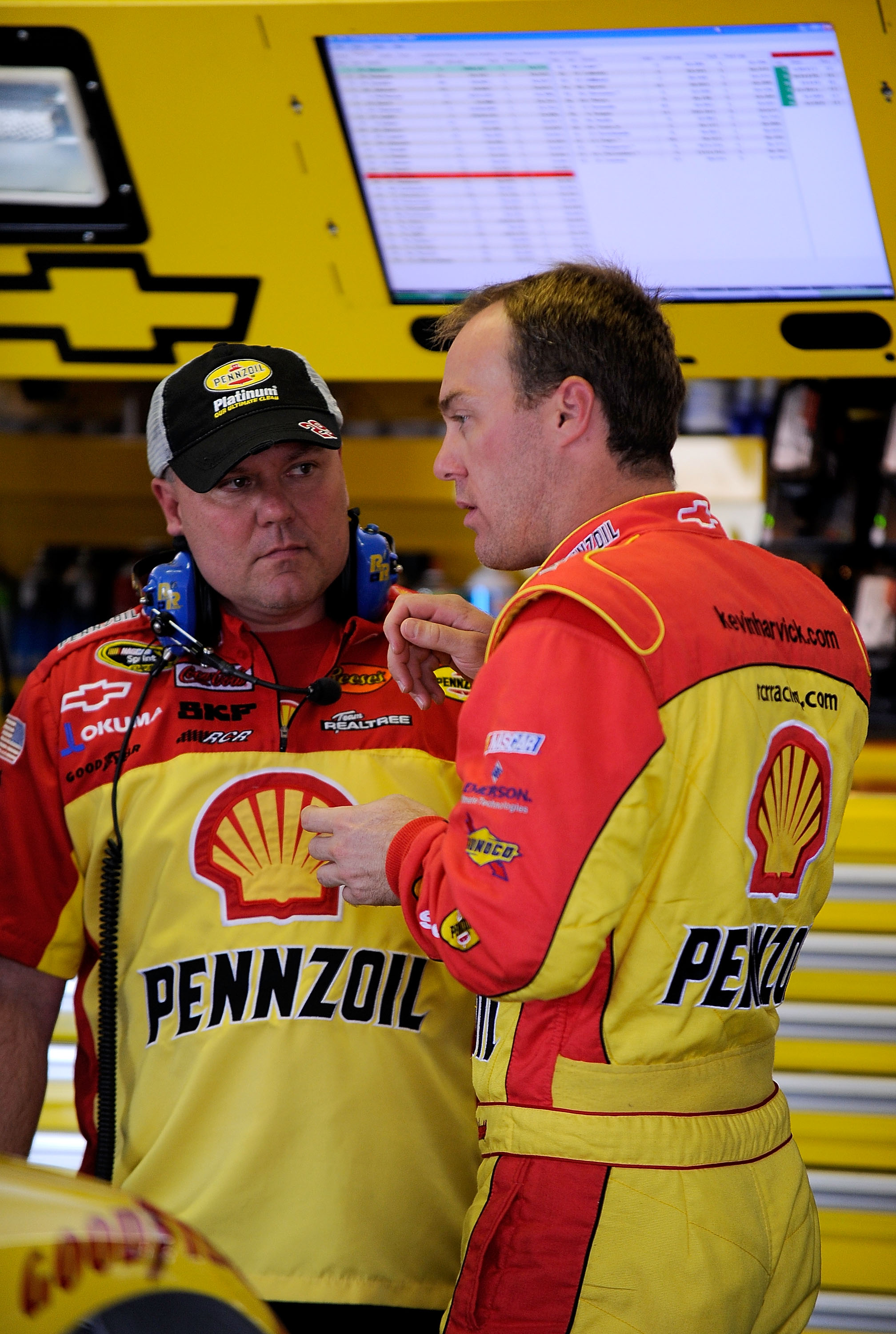 LONG POND, PA - JUNE 04:  Kevin Harvick (R), driver of the #29 Shell/Pennzoil Chevrolet, talks with a crew chief Gil Martin in the garage prior to practice for the NASCAR Sprint Cup Series Gillette Fusion ProGlide 500 at Pocono Raceway on June 4, 2010 in