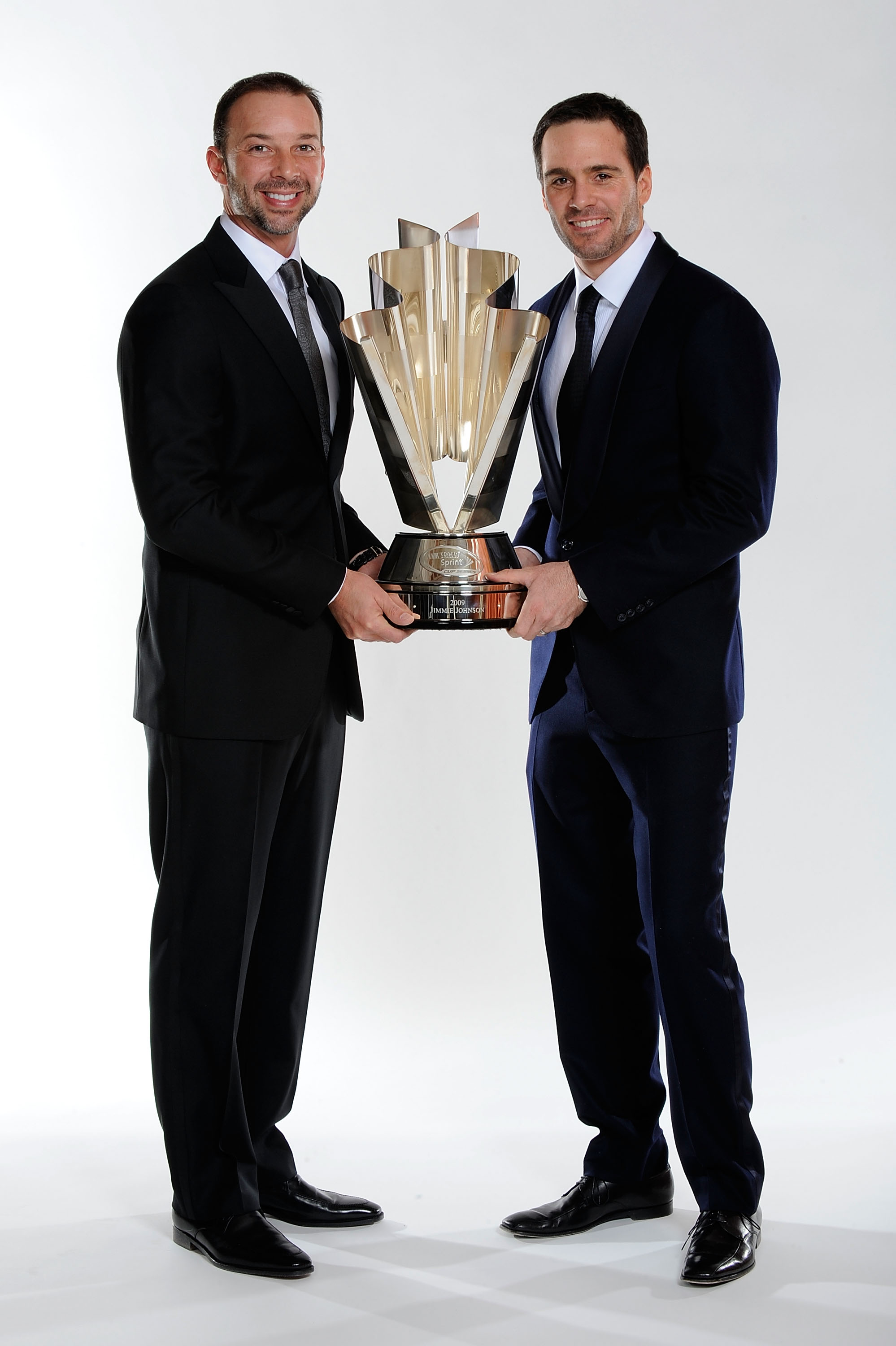 LAS VEGAS - DECEMBER 04:  Four time NASCAR Sprint Cup Series Champion Jimmie Johnson (R) and crew chief Chad Knaus pose before the NASCAR Sprint Cup Series awards banquet during the final day of the NASCAR Sprint Cup Series Champions Week on December 4, 2