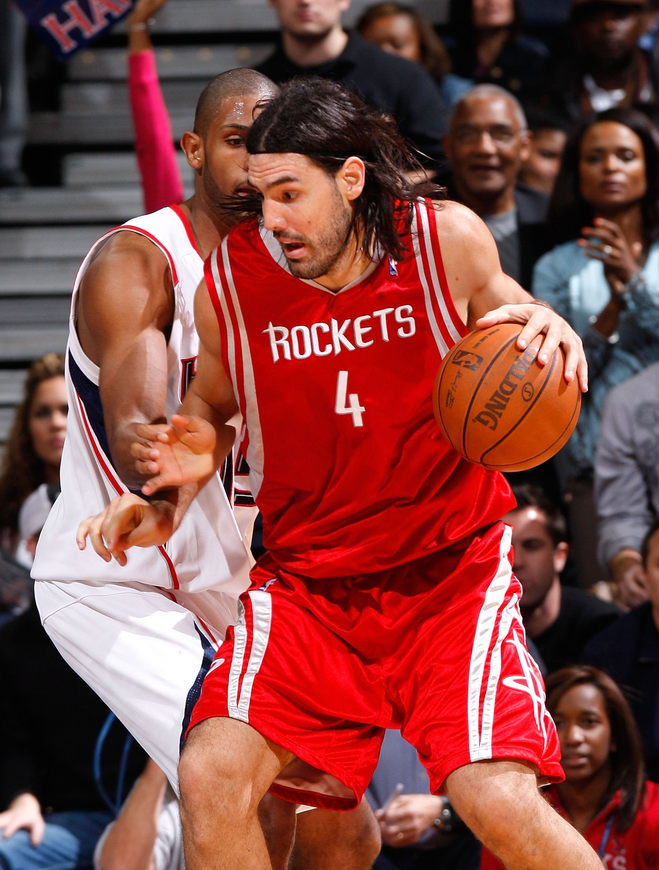 ATLANTA - NOVEMBER 20:  Luis Scola #4 of the Houston Rockets against Al Horford #15 of the Atlanta Hawks at Philips Arena on November 20, 2009 in Atlanta, Georgia.  NOTE TO USER: User expressly acknowledges and agrees that, by downloading and/or using thi