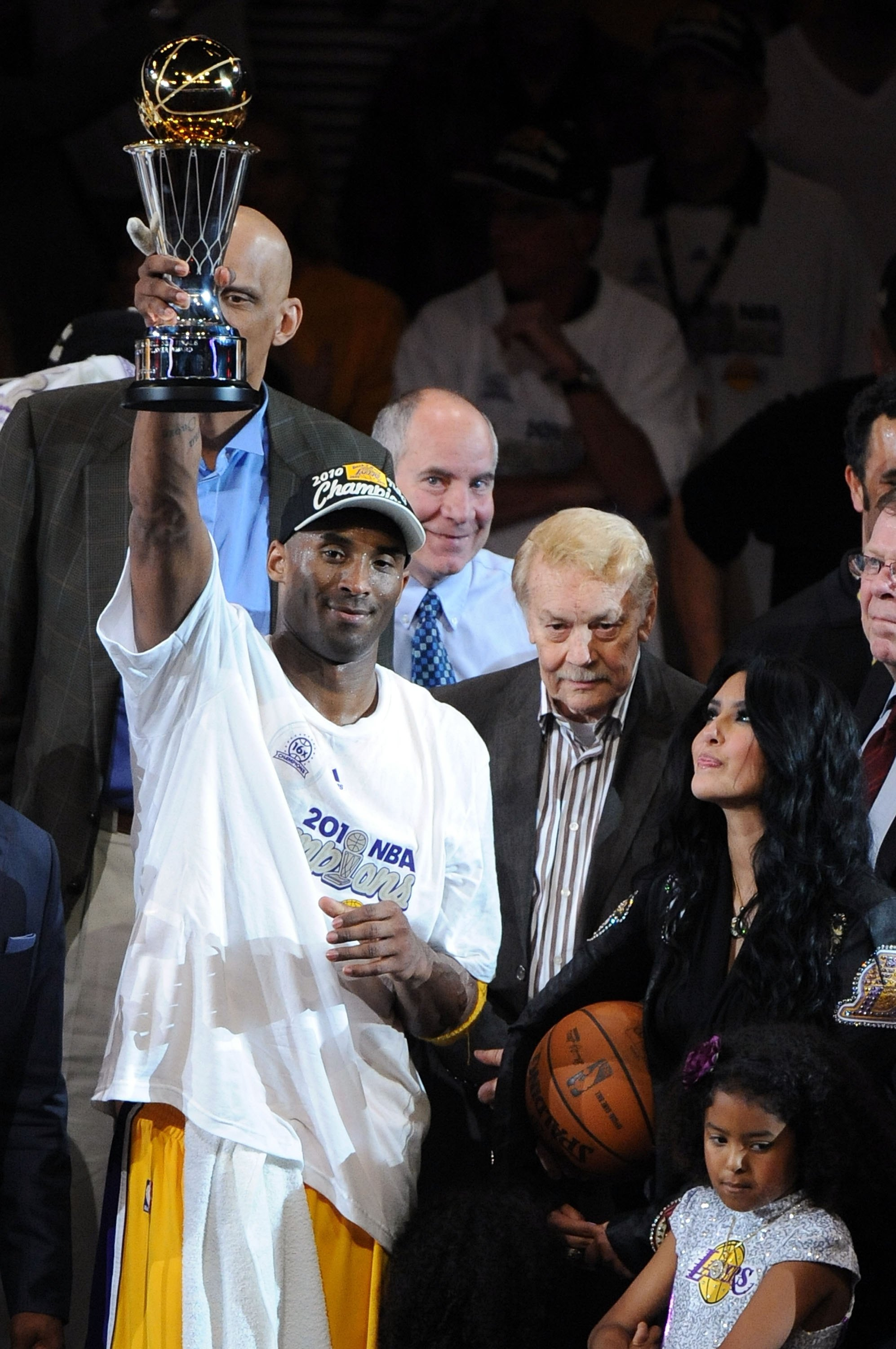 LOS ANGELES, CA - JUNE 17:  Kobe Bryant #24 of the Los Angeles Lakers holds up the Bill Russell Finals MVP trophy alongside team owner Dr. Jerry Buss and Bryant's wife Vanessa after the Lakers defeated the Boston Celtics 83-79 in Game Seven of the 2010 NB