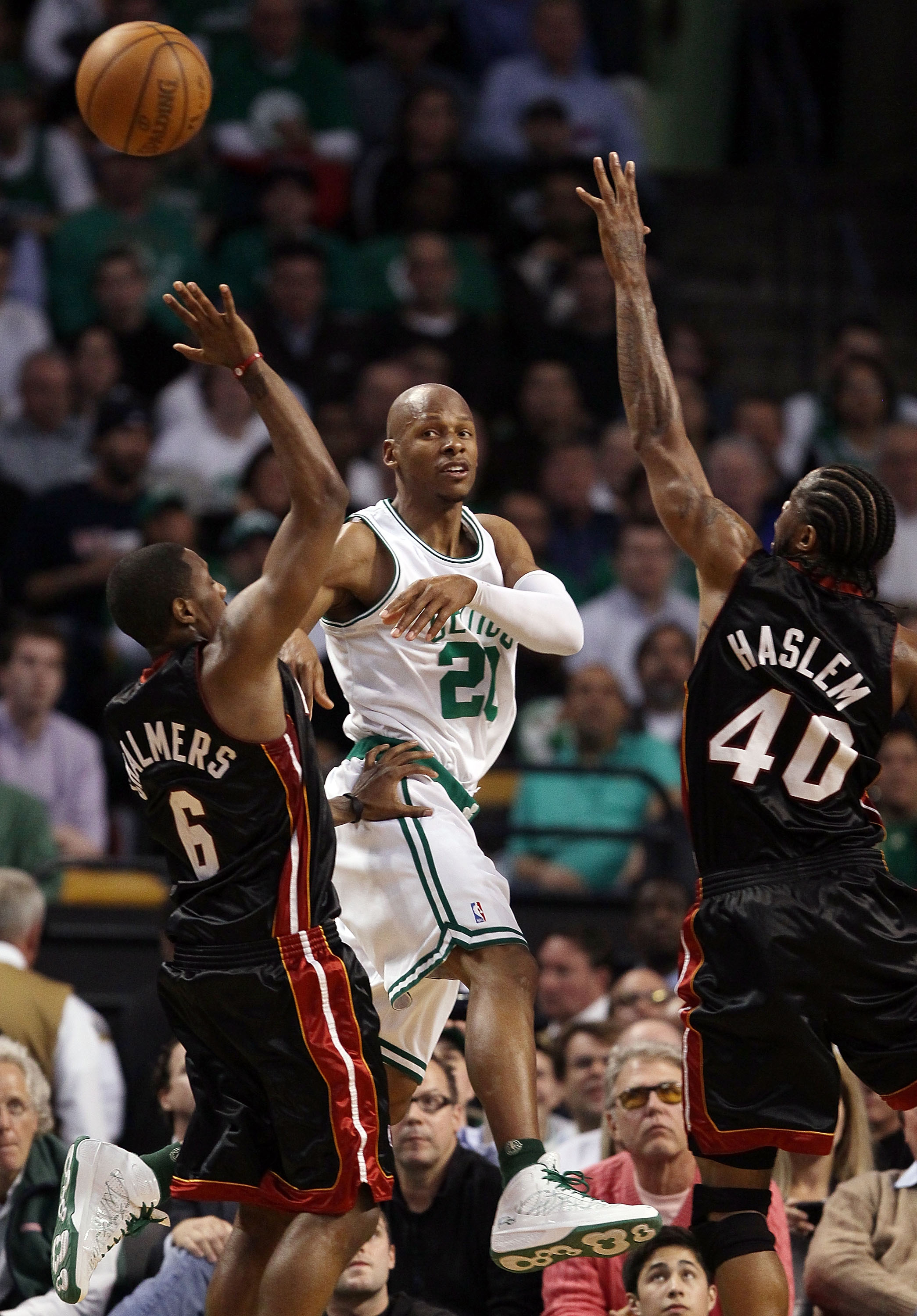 BOSTON - APRIL 27:  Ray Allen #20 of the Boston Celtics passes the ball under pressure from Mario Chalmers #6 and Udonis Haslem #40 of the Miami Heat during Game Five of the Eastern Conference Quarterfinals of the 2010 NBA playoffs at the TD Garden on Apr
