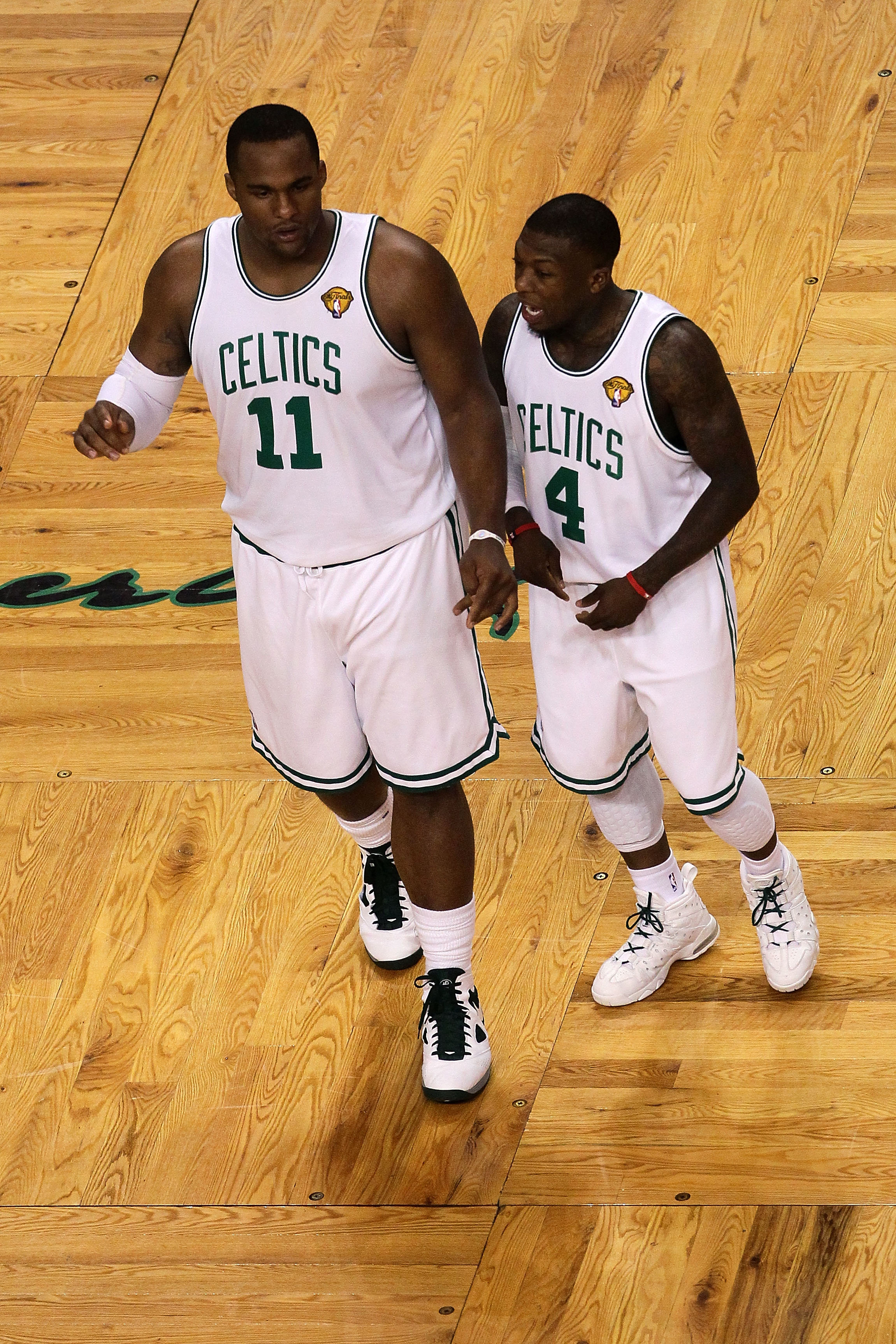 BOSTON - JUNE 10:  (L-R) Glen Davis #11 and Nate Robinson #4 of the Boston Celltics talk on court against the Los Angeles Lakers during Game Four of the 2010 NBA Finals on June 10, 2010 at TD Garden in Boston, Massachusetts. NOTE TO USER: User expressly a