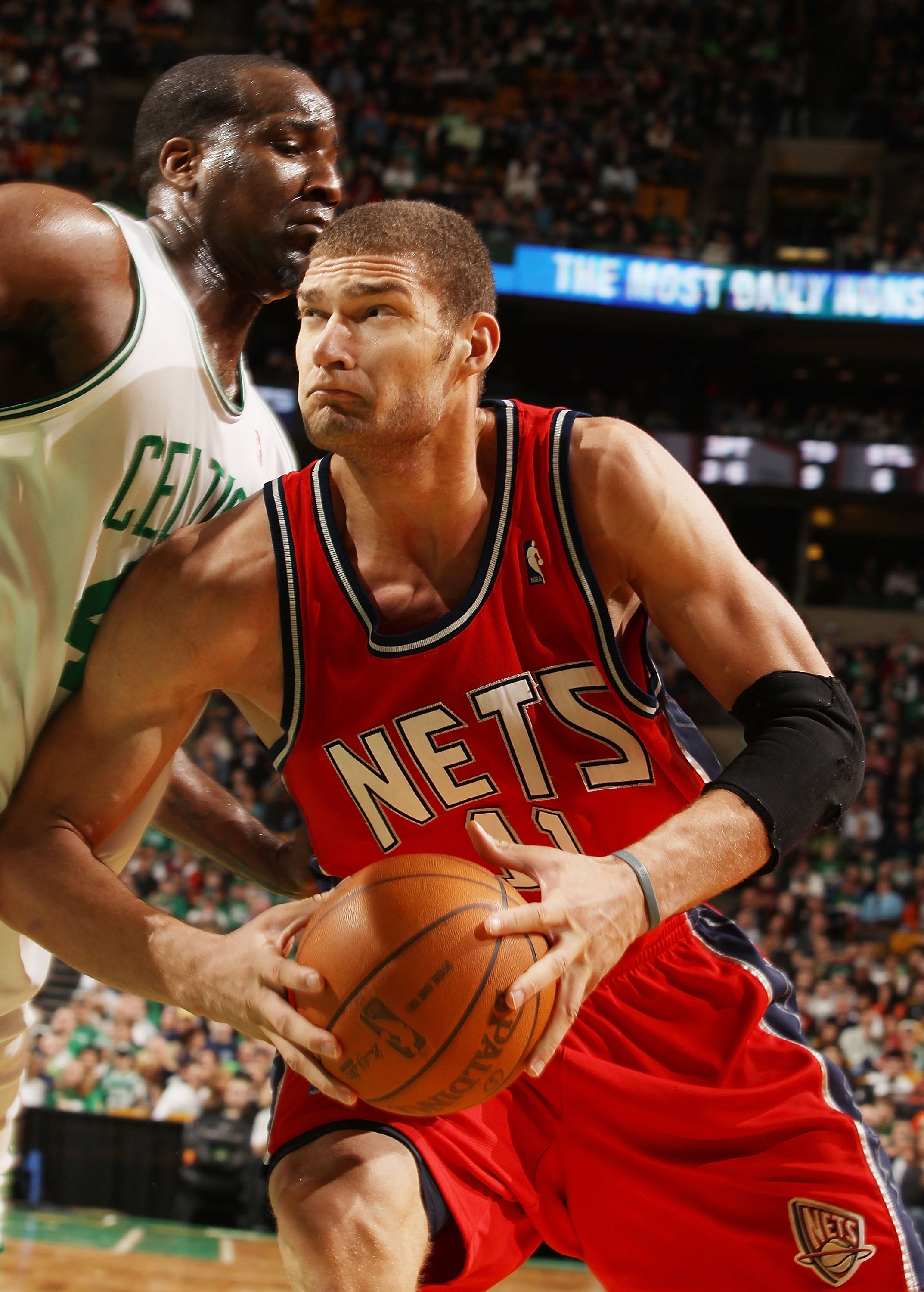 BOSTON - FEBRUARY 27:  Brook Lopez #11 of the New Jersey Nets heads for the net as Kendrick Perkins #43 of the Boston Celtics defends at the TD Garden on February 27, 2010 in Boston, Massachusetts. The Nets defeated the Celtics 104-96.  NOTE TO USER: User