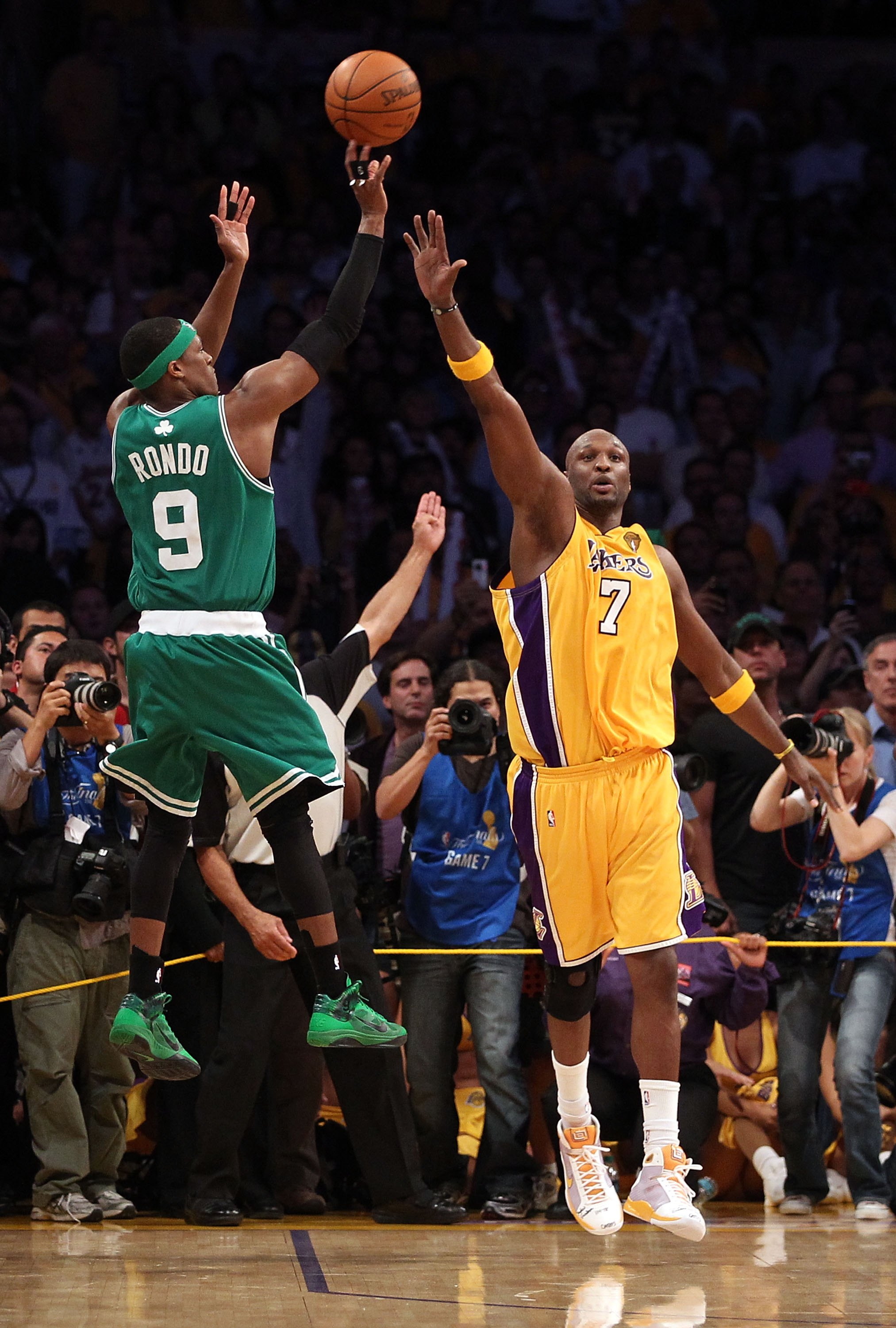 LOS ANGELES, CA - JUNE 17:  Rajon Rondo #9 of the Boston Celtics shoots a three-pointer in the final seconds over Lamar Odom #7 of the Los Angeles Lakers before the Celtics loss to the Los Angeles Lakers in Game Seven of the 2010 NBA Finals at Staples Cen