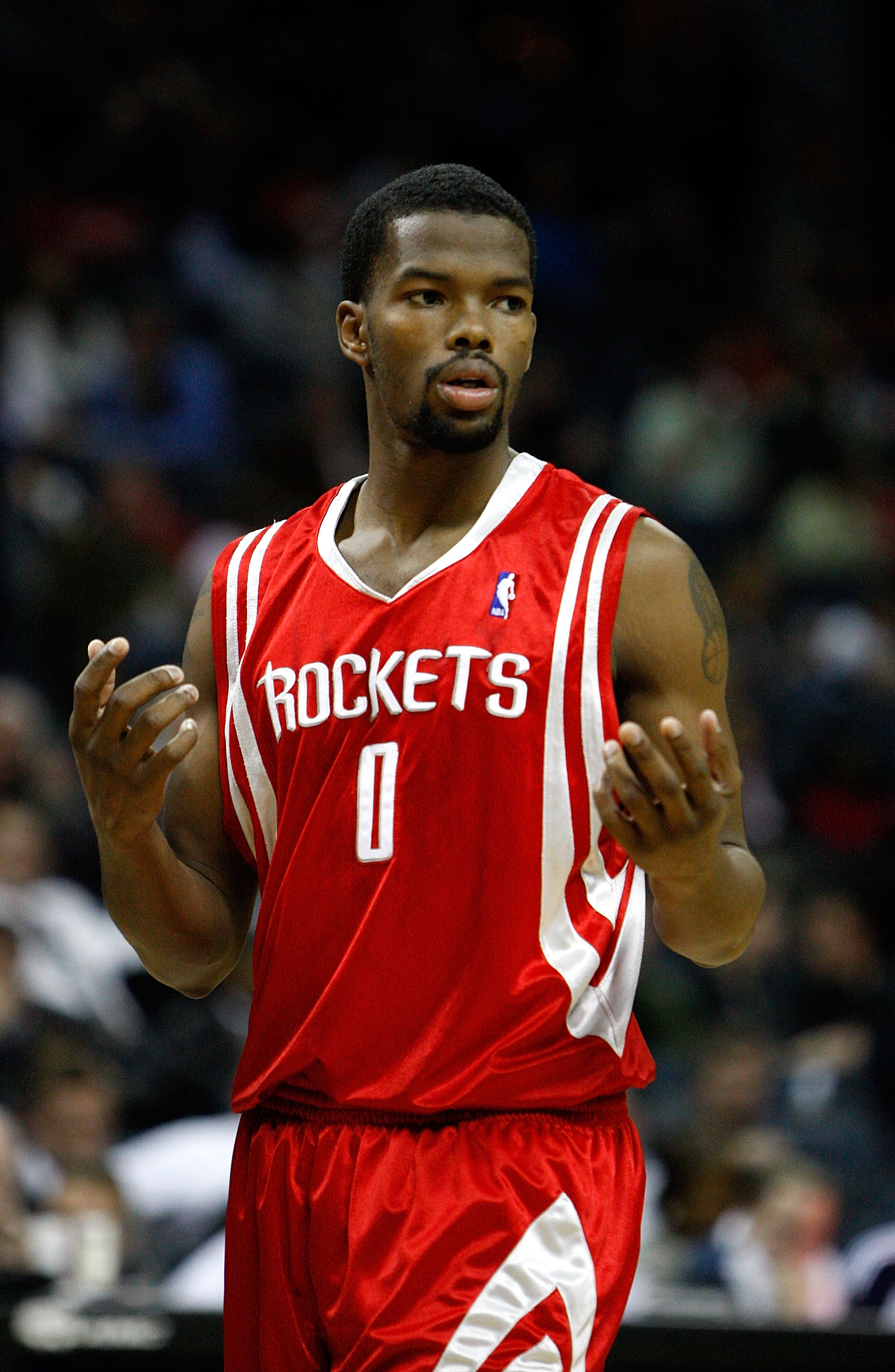 CHARLOTTE, NC - JANUARY 12:  Aaron Brooks #0 of the Houston Rockets reacts to his team against the Charlotte Bobcats at Time Warner Cable Arena on January 12, 2010 in Charlotte, North Carolina.  NOTE TO USER: User expressly acknowledges and agrees that, b