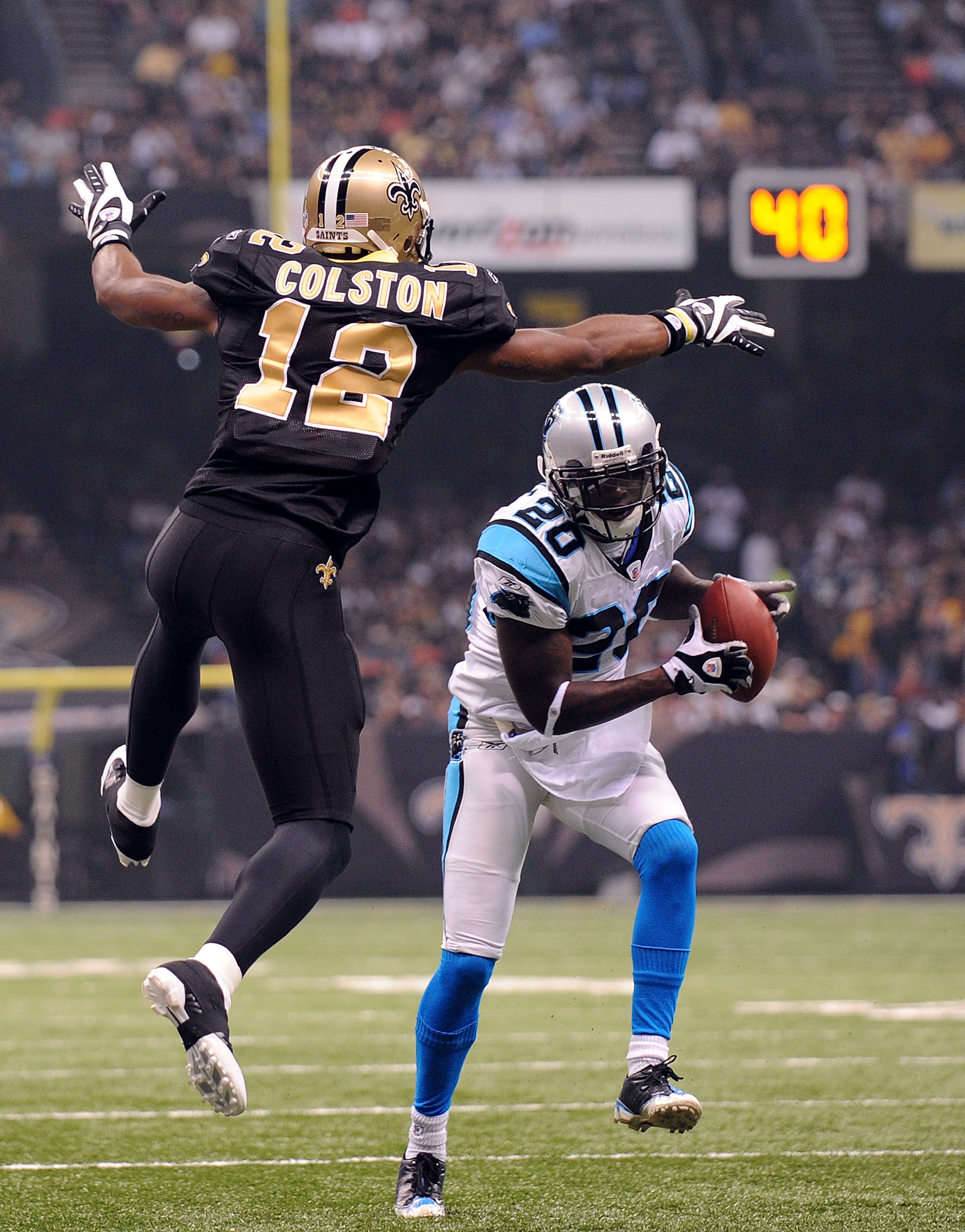 NEW ORLEANS - NOVEMBER 08:  Cornerback Chris Gamble #20 of the Carolina Panthers intercepts a pass intended for Marques Colston #12 of the New Orleans Saints at Louisiana Superdome on November 8, 2009 in New Orleans, Louisiana.  (Photo by Ronald Martinez/