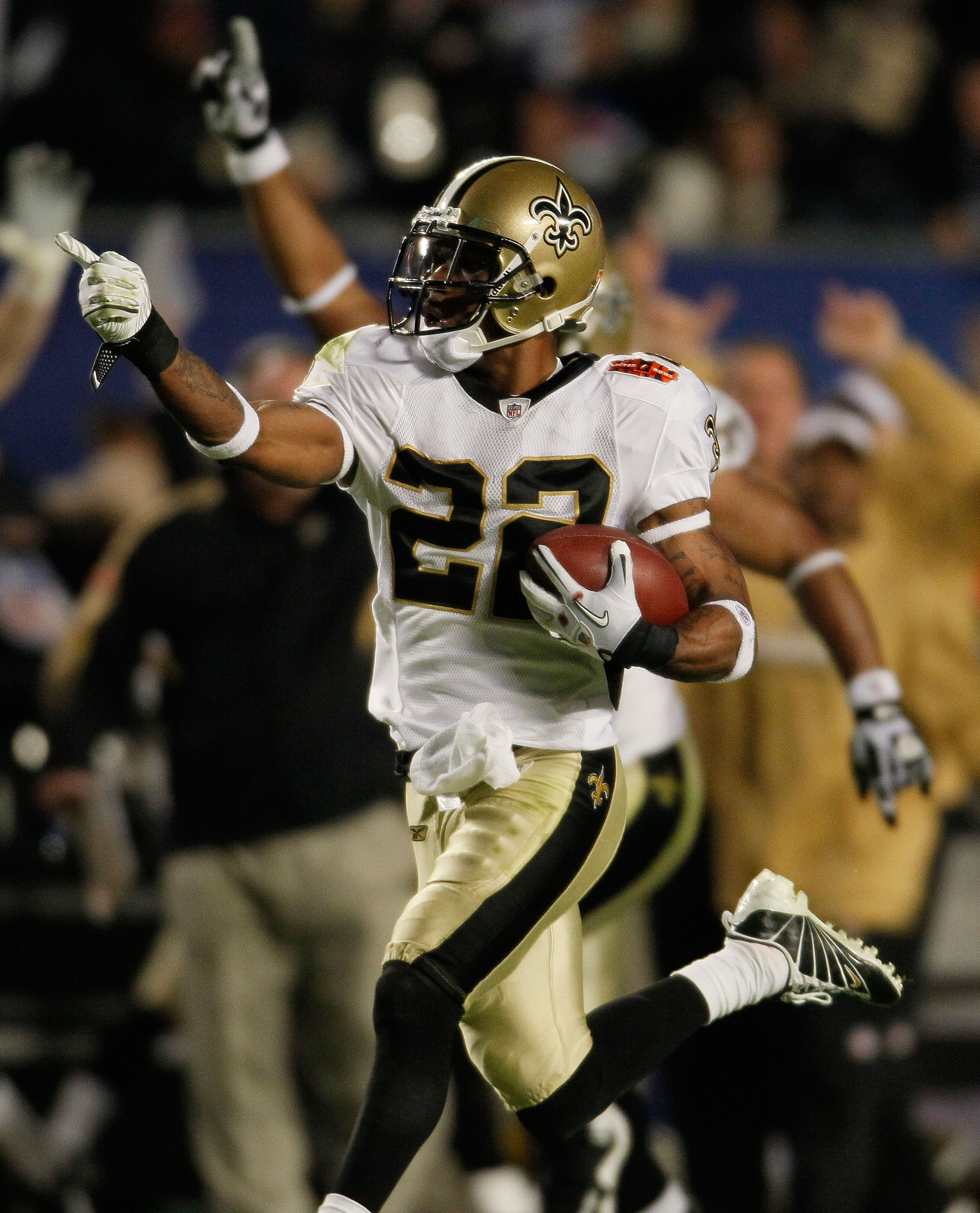 MIAMI GARDENS, FL - FEBRUARY 07:  Tracy Porter #22 of the New Orleans Saints intercepts a ball thrown by Peyton Manning of the Indianapolis Colts and returns it for a touchdown in the fourth quarter during Super Bowl XLIV on February 7, 2010 at Sun Life S