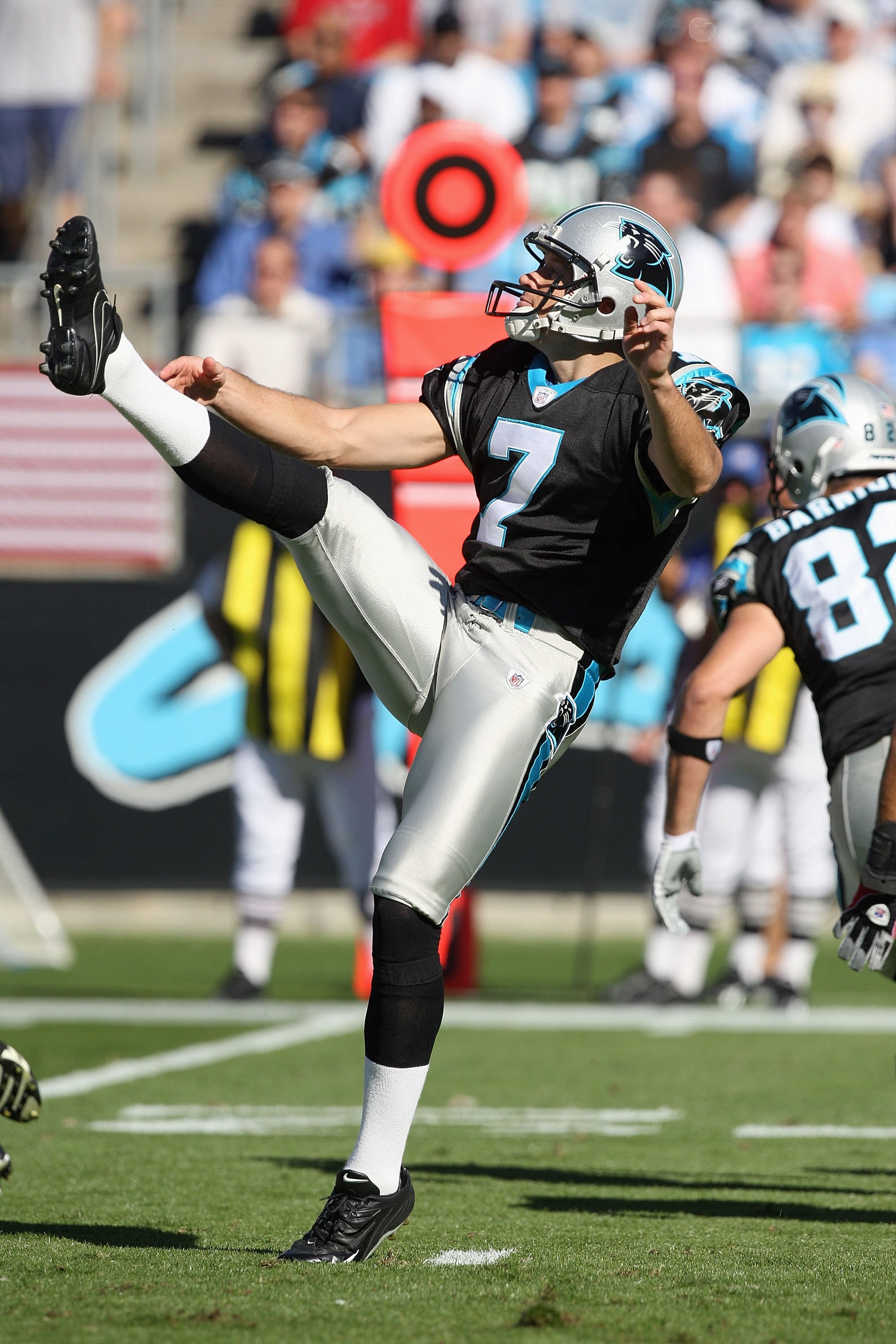CHARLOTTE, NC - NOVEMBER 15:  Jason Baker #7 of the Carolina Panthers punts the ball during the game against the Atlanta Falcons at Bank of America Stadium on November 15, 2009 in Charlotte, North Carolina.  (Photo by Streeter Lecka/Getty Images)