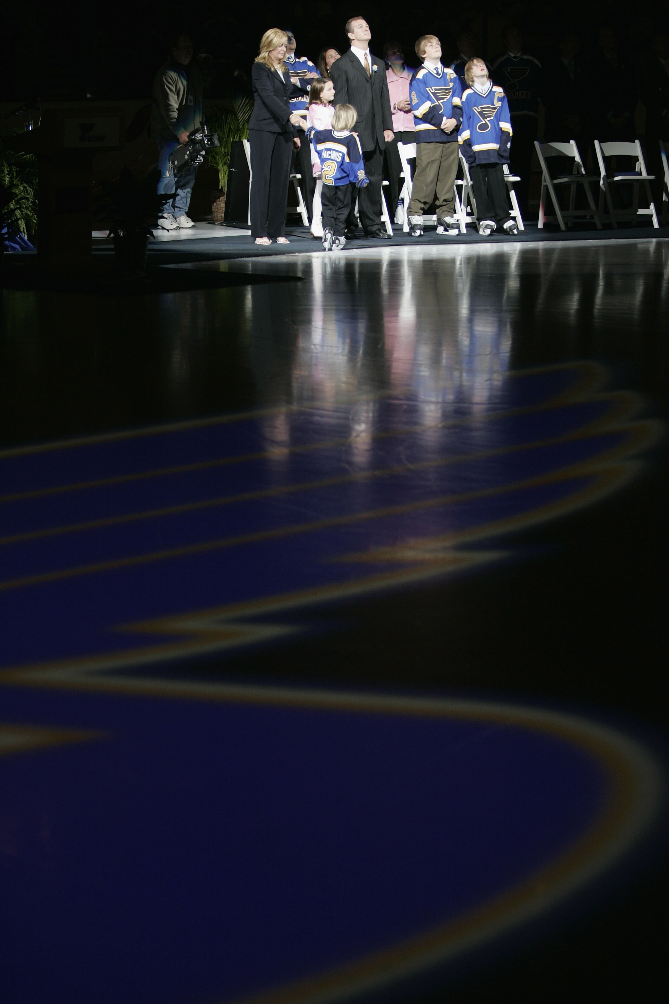 ST. LOUIS - APRIL 9:  Former St. Louis Blues defenseman Al MacInnis #2 and his family watch his banner being raised during his jersey retirement ceremony prior to the game between the Blues and Edmonton Oilers at the Savvis Center on April 9, 2006 in St.