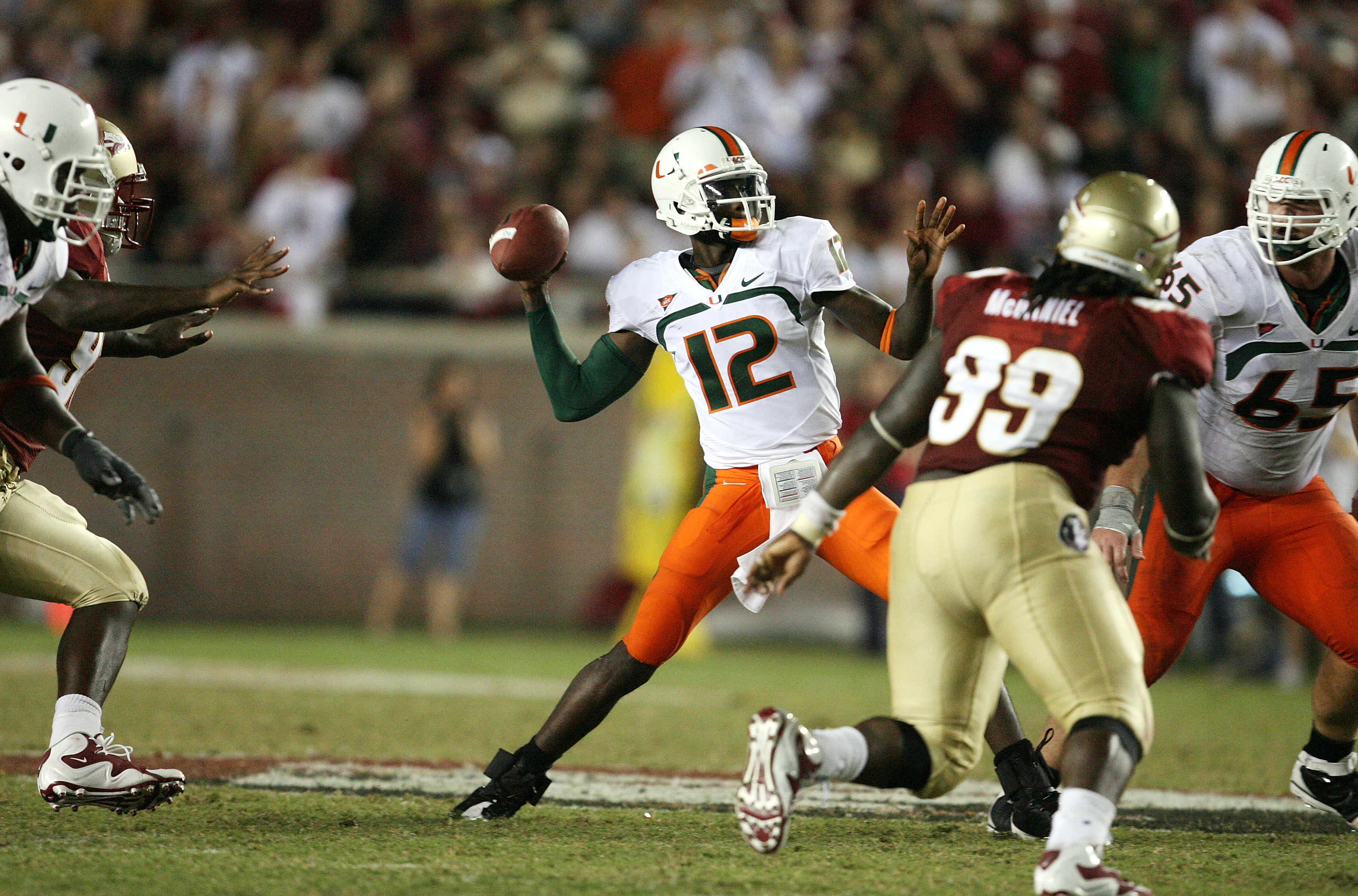 TALLAHASSEE, FL - SEPTEMBER 07:  Quarterback Jacory Harris #12 of the Miami Hurricanes throws a touchdown pass in the fourth quarter to Graig Cooper #2 against the Florida State Seminoles at Doak Campbell Stadium on September 7, 2009 in Tallahassee, Flori