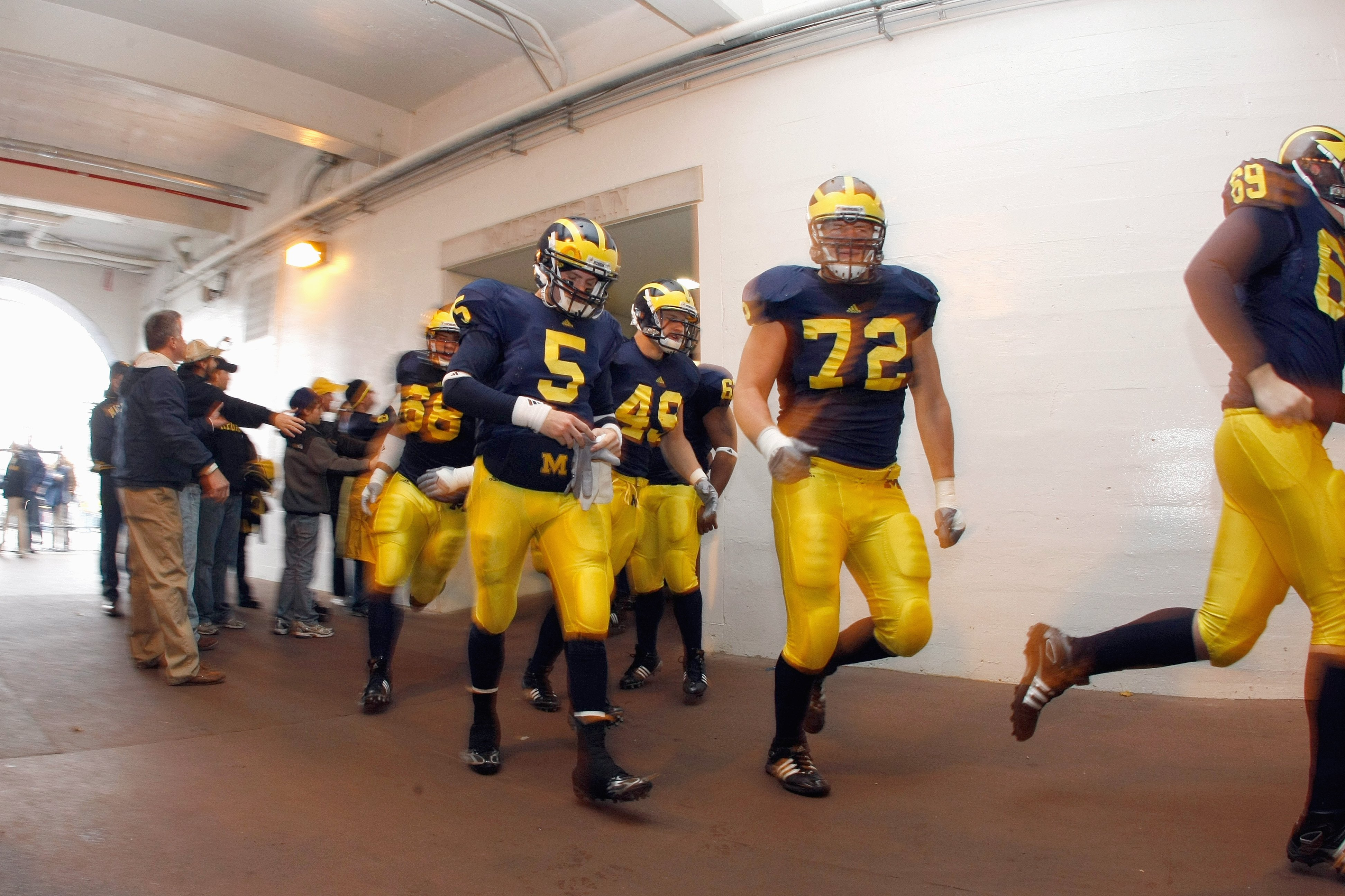 ANN ARBOR, MI - NOVEMBER 21: Quarteback Tate Forcier #5 of the Michigan Wolverines walks through the tunnel before the game against the Ohio State Buckeyes on November 21, 2009 at Michigan Stadium in Ann Arbor, Michigan. Ohio State won the game 21-10. (Ph