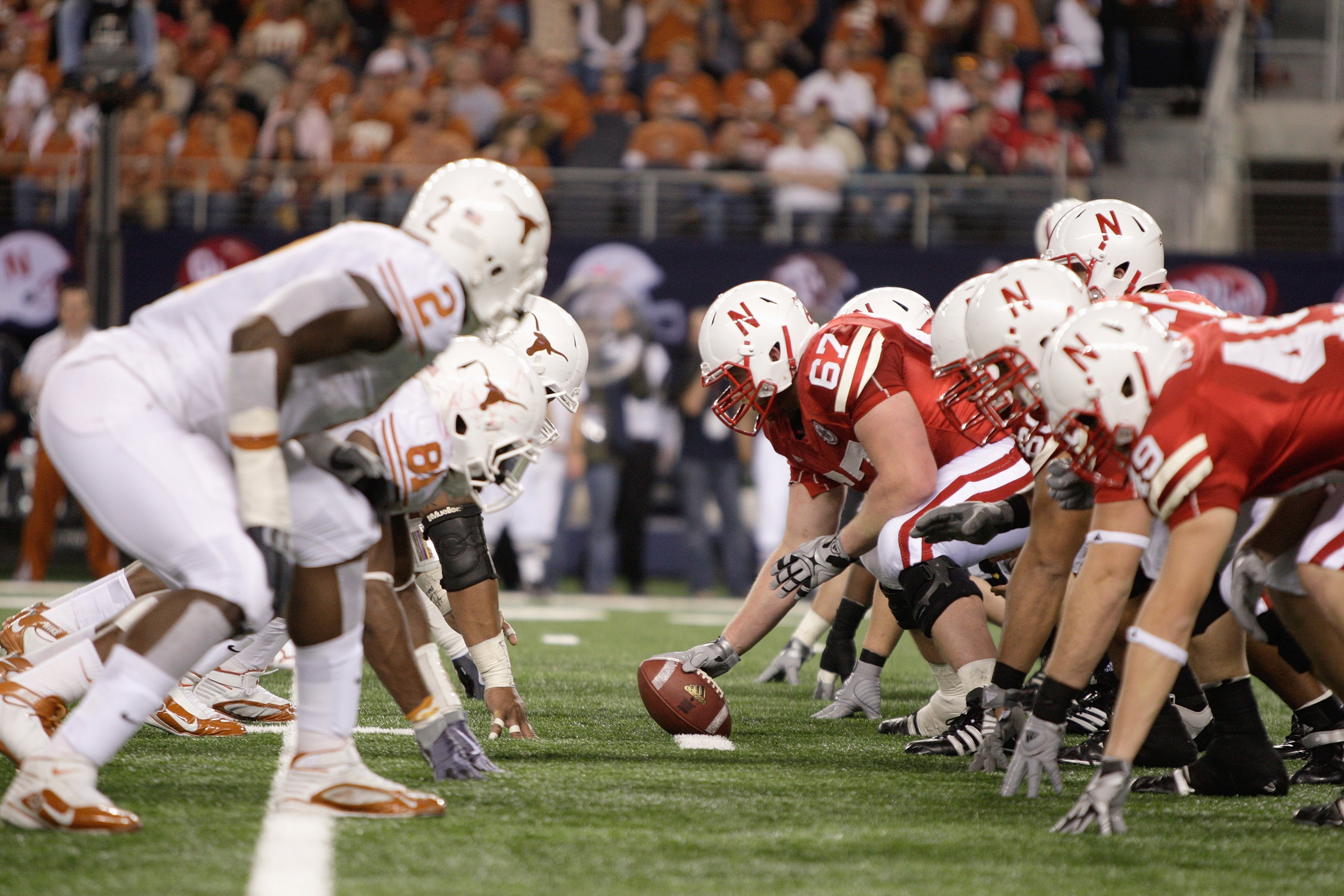 ARLINGTON, TX - DECEMBER 5: Sam Meginnis #67 of the Nebraska Cornhuskers gets ready to hike the ball during the Big 12 Football Championship game against the Texas Longhorns at Cowboys Stadium on December 5, 2009 in Arlington, Texas. (Photo by Jamie Squir