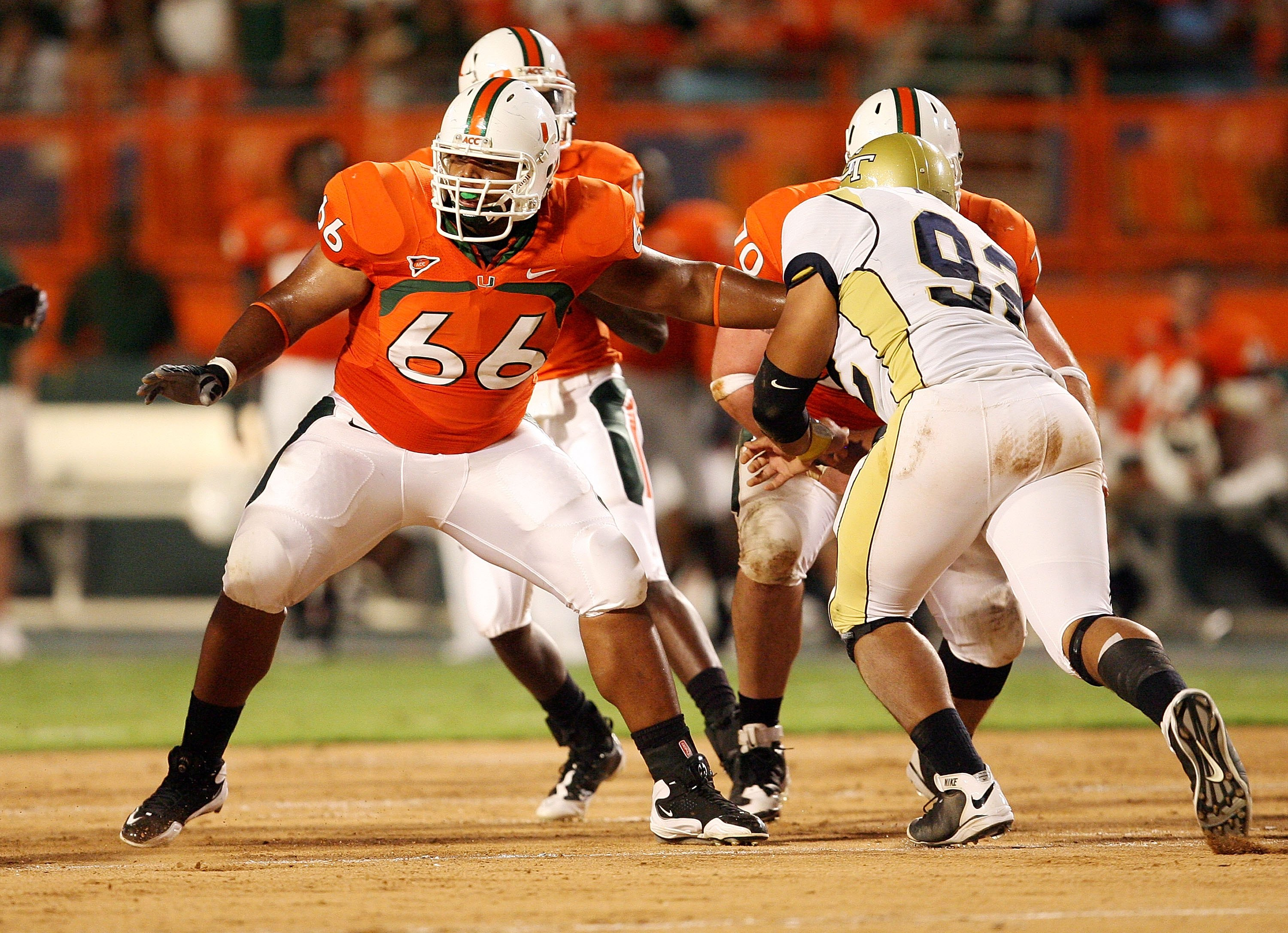 MIAMI GARDENS, FL - SEPTEMBER 17:  Offensive lineman Harland Gunn #66 of the Miami Hurricanes drops back to pass block while taking on the Georgia Tech Yellow Jackets at Land Shark Stadium on September 17, 2009 in Miami Gardens, Florida. Miami defeated Ge