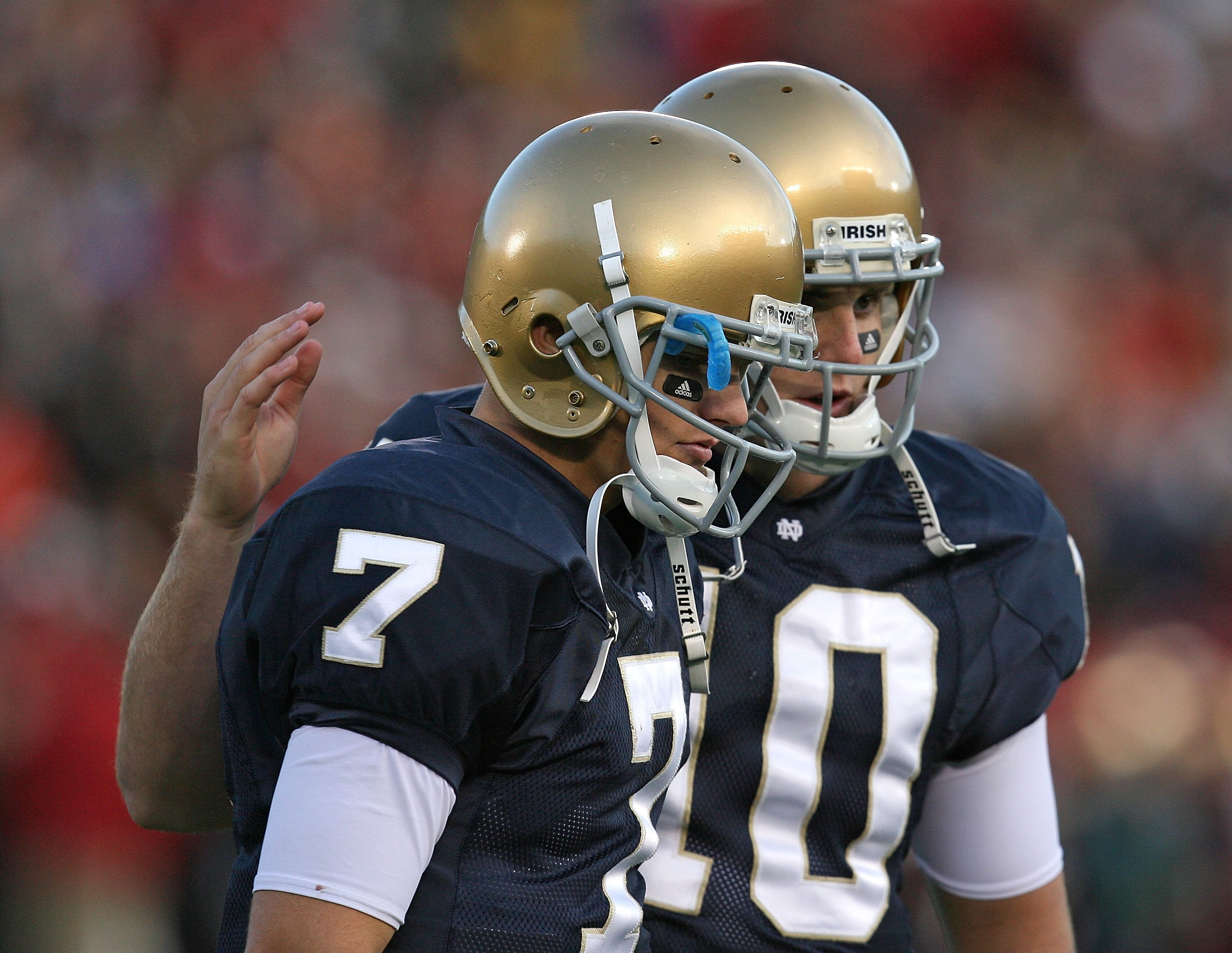 SOUTH BEND, IN - OCTOBER 17: Jimmy Clausen #7 of the Notre Dame Fighting Irish is consoled by teammate Dayne Crist #10 during a game against the USC Trojans at Notre Dame Stadium on October 17, 2009 in South Bend, Indiana. USC defeated Notre Dame 34-27. (