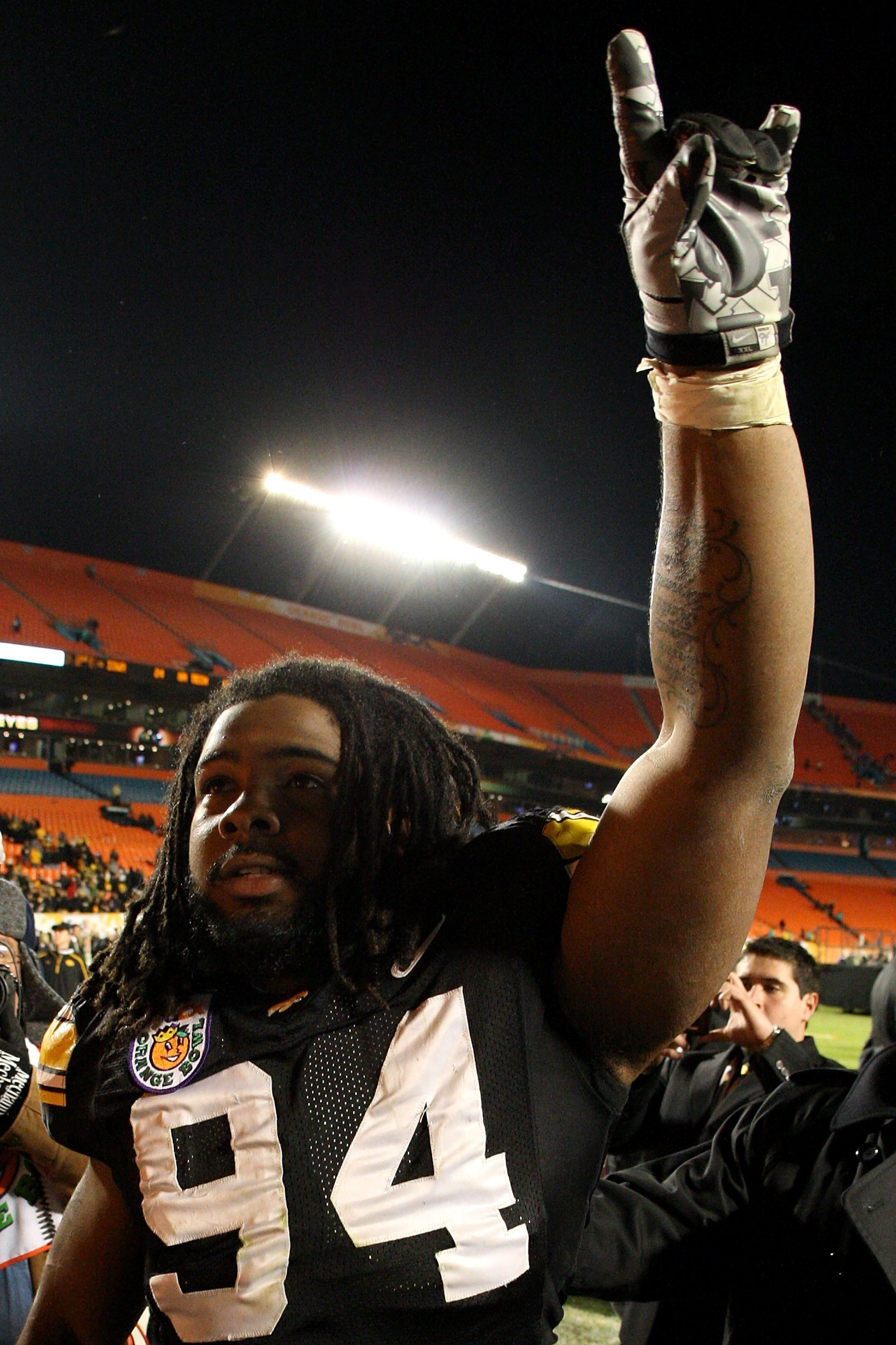 MIAMI GARDENS, FL - JANUARY 05:  Adrian Clayborn #94 of the Iowa Hawkeyes celebrates as he walks off the field after their 24-14 win against the Georgia Tech Yellow Jackets during the FedEx Orange Bowl at Land Shark Stadium on January 5, 2010 in Miami Gar