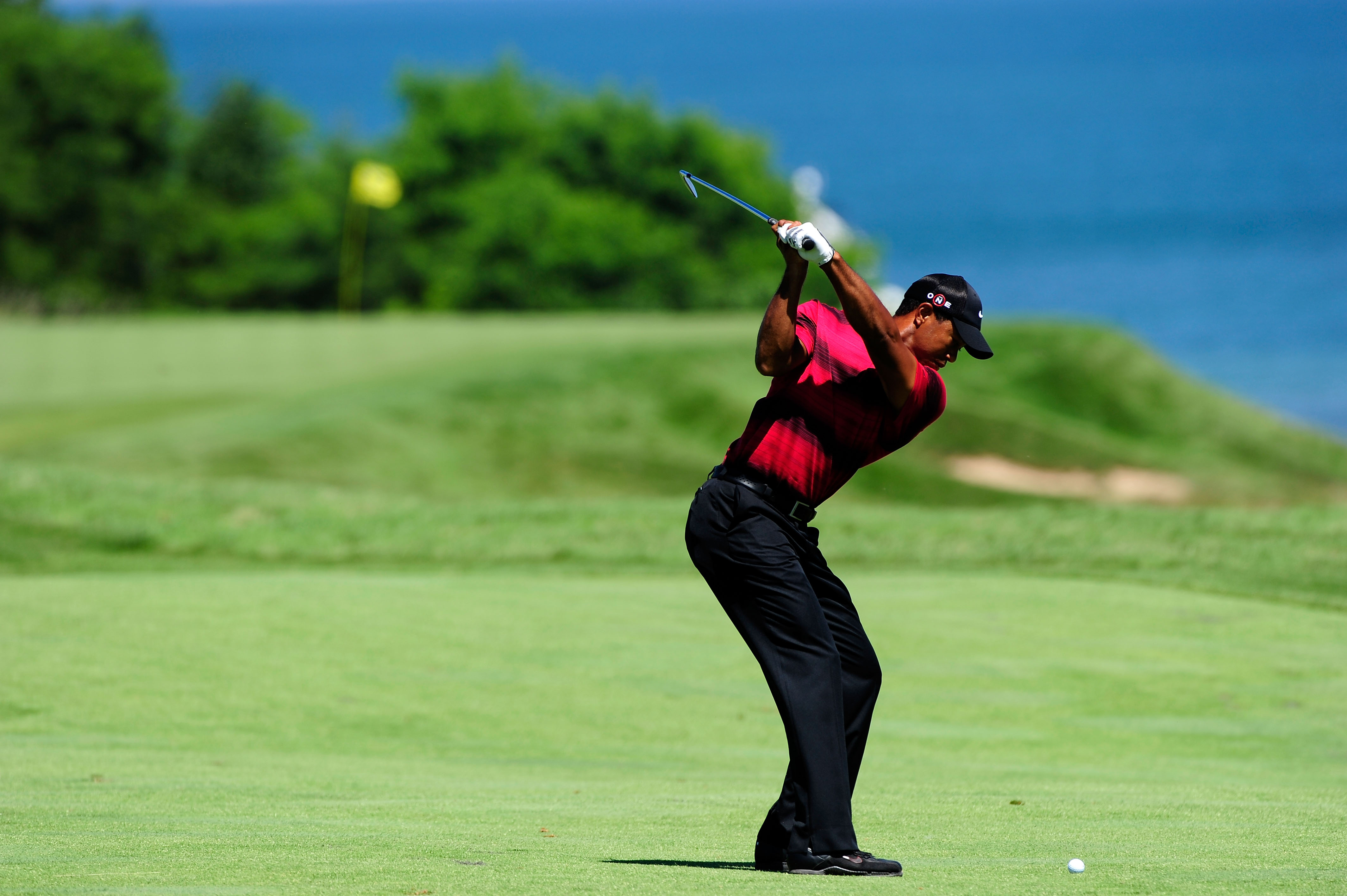 KOHLER, WI - AUGUST 15:  Tiger Woods plays his approach shot on the eighth hole during the final round of the 92nd PGA Championship on the Straits Course at Whistling Straits on August 15, 2010 in Kohler, Wisconsin.  (Photo by Stuart Franklin/Getty Images