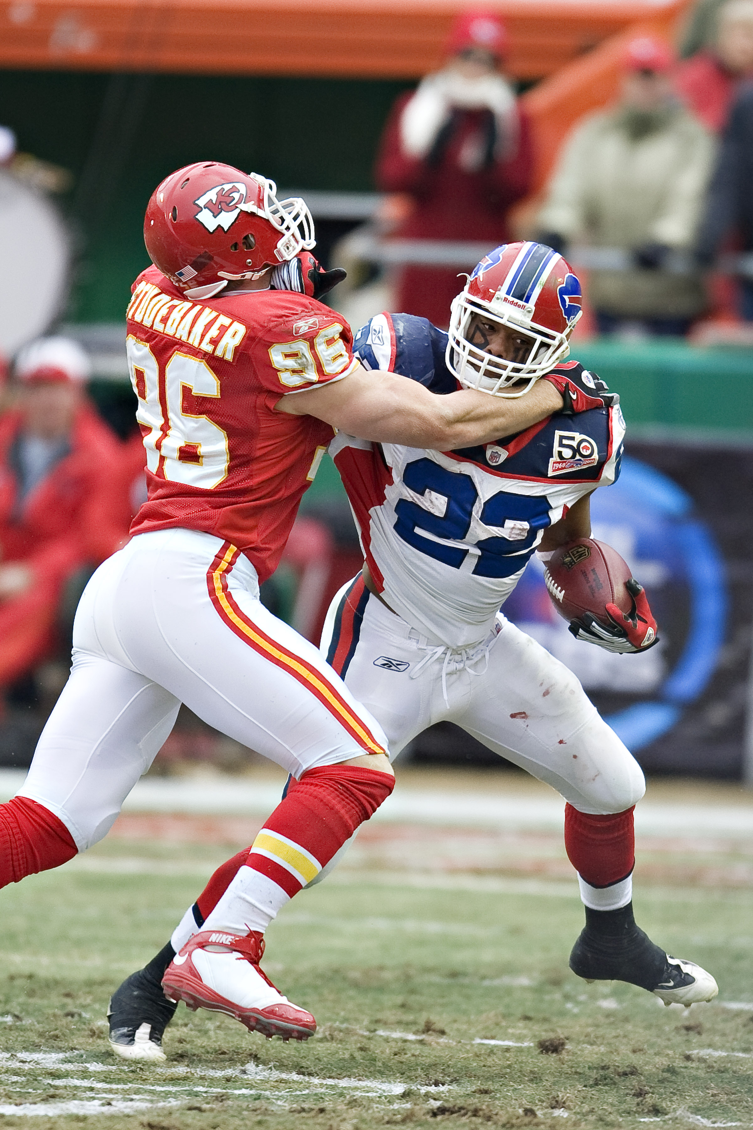 KANSAS CITY, MO - DECEMBER 13: Running back Fred Jackson #22 of the Buffalo Bills stiff arms linebacker Andy Studebaker #96 of the Kansas City Chiefs at Arrowhead Stadium on December 13, 2009 Kansas City, Missouri.  The Bills defeated the Chiefs 16-10.  (