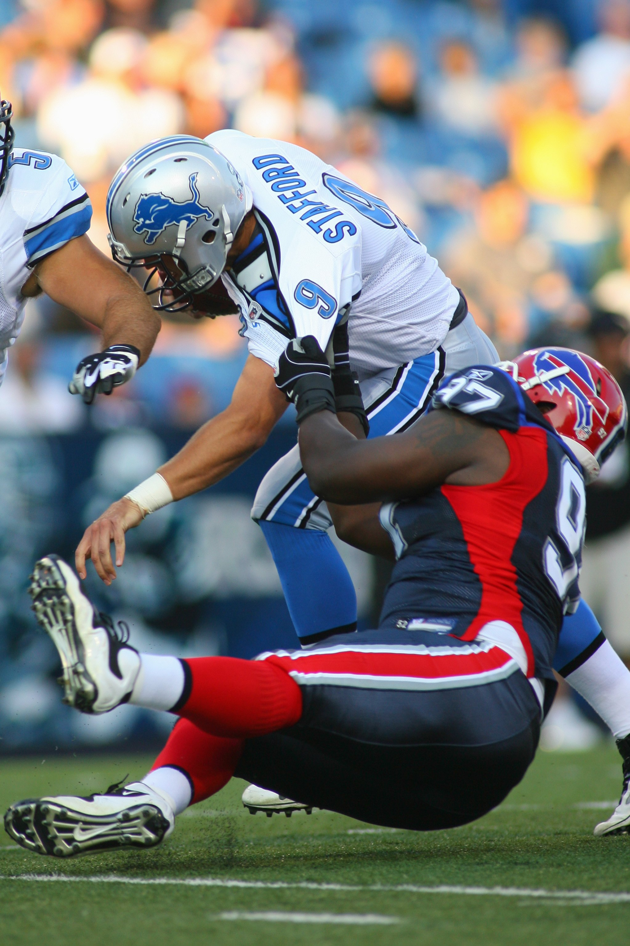 ORCHARD PARK, NY - SEPTEMBER 3:  John McCargo #97 of the Buffalo Bills sacks Matthew Stafford #9 of the Detroit Lions during the preseason game at Ralph Wilson Stadium on September 3, 2009 in Orchard Park, New York. (Photo by Rick Stewart/Getty Images)