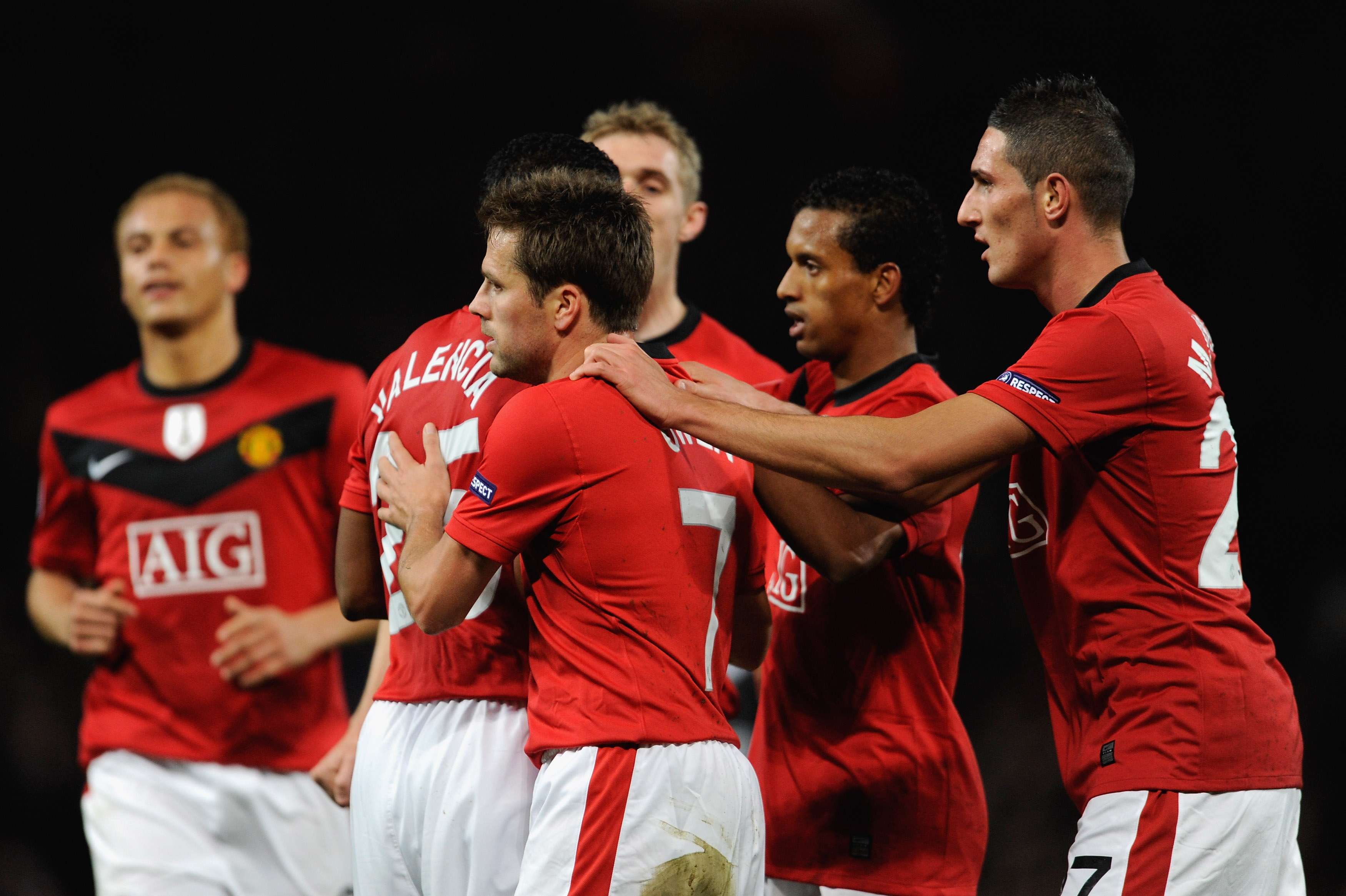 MANCHESTER, ENGLAND - NOVEMBER 03:  Michael Owen of Manchester United is congratulated by his team mates after scoring his team's first goal during the UEFA Champions League Group B match between Manchester United and CSKA Moscow at Old Trafford on Novemb