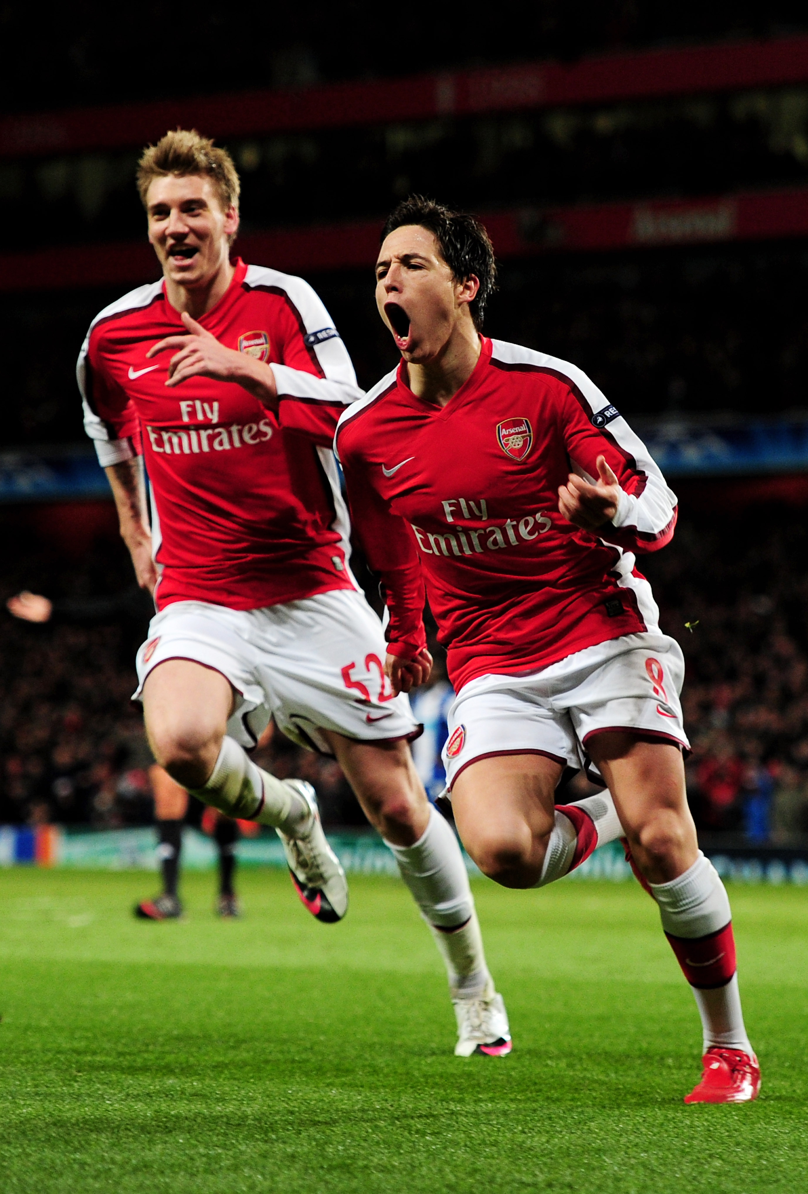 LONDON, ENGLAND - MARCH 09:  Samir Nasri (R) of Arsenal celebrates with teammate Nicklas Bendtner after scoring his team's third goal during the UEFA Champions League round of 16 match between Arsenal and FC Porto at the Emirates Stadium on March 9, 2010
