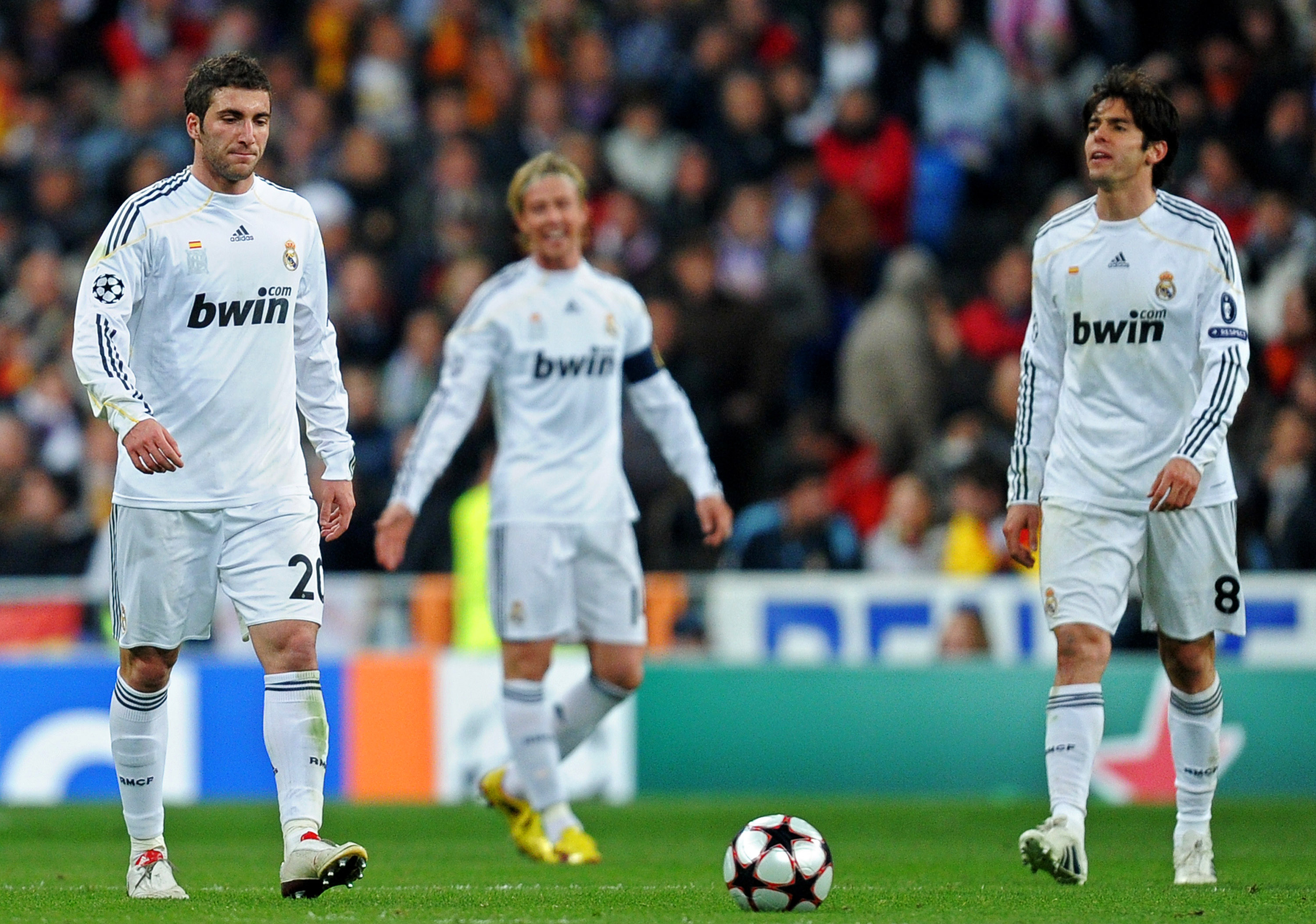 MADRID, SPAIN - MARCH 10:  Gonzalo Higuain (L) of Real Madrid trudges back to the half way line with his team mates Kaka (R) and Jose Maria Gutierrez after conceding a goal during the UEFA Champions League round of 16 second leg match between Real Madrid