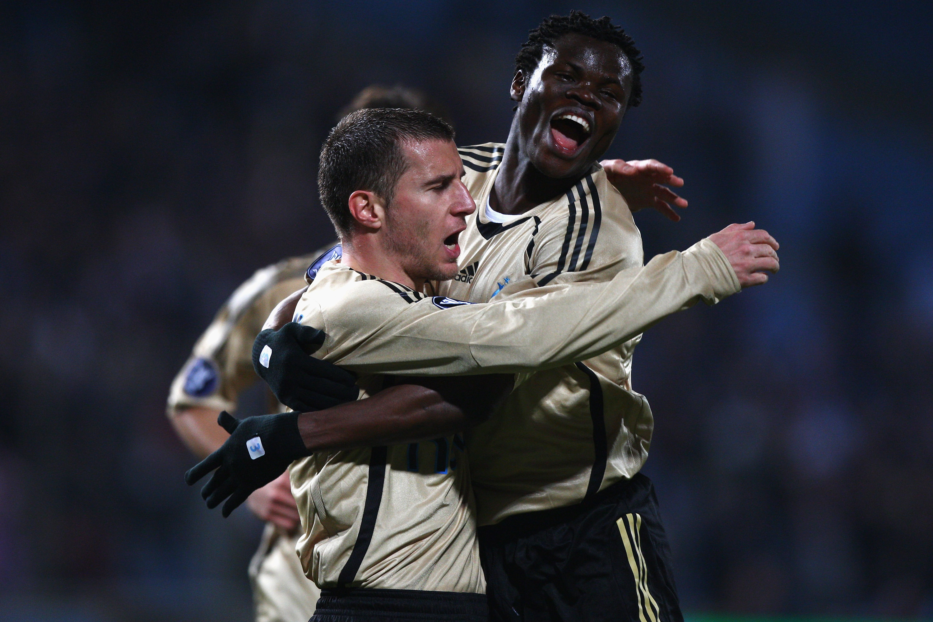 MARSEILLE, FRANCE - MARCH 12: Benoit Cheyrou (L) celebrates scoring the first goal with Ismaila Taiwo Taye (r) during the Uefa Cup last sixteen first leg match between Olympique Marseille and Ajax at the Stade Velodrome on March 12, 2009 in Marseille,Fran