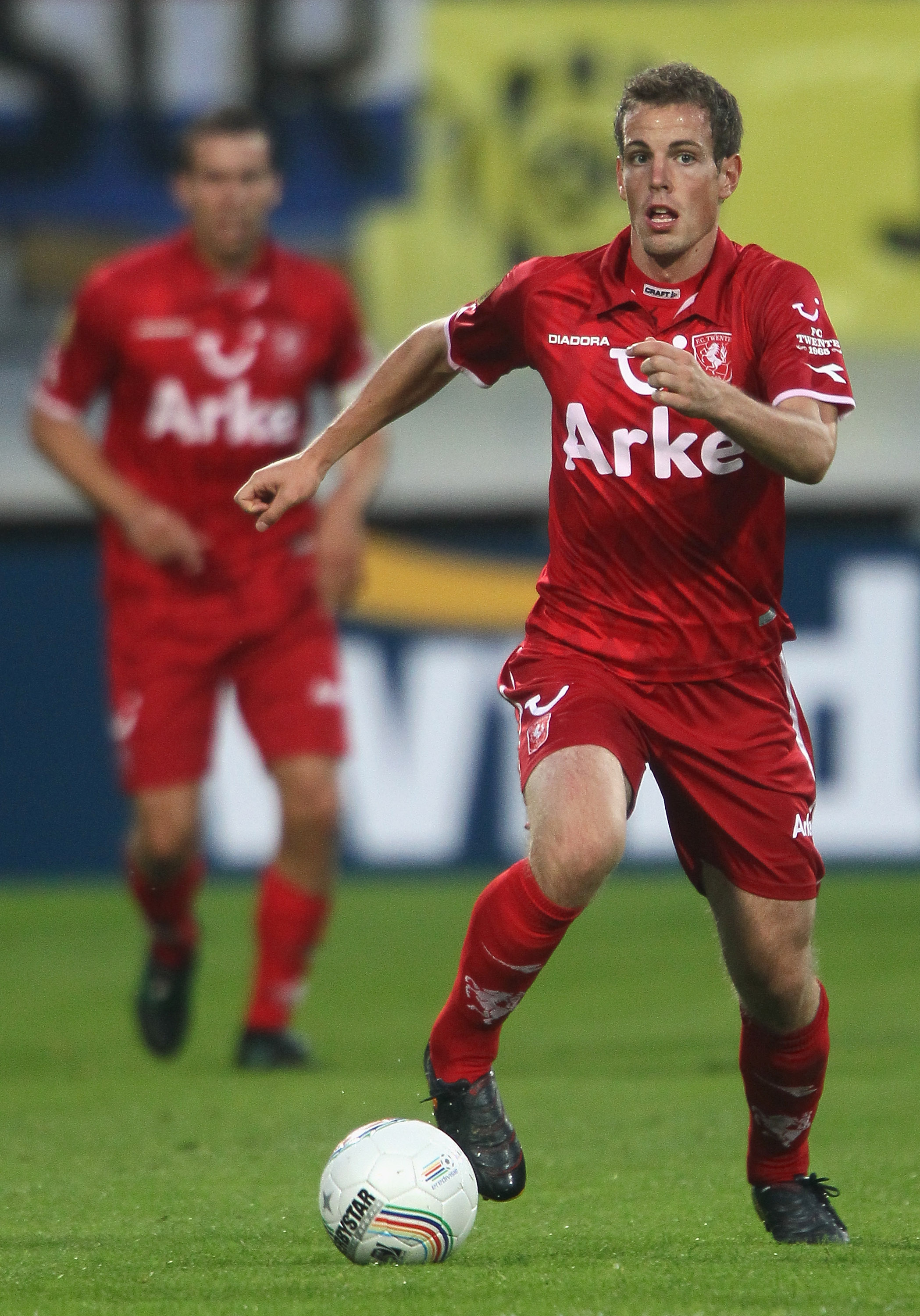 KERKRADE, NETHERLANDS - AUGUST 06:  Wout Brama of Enschede runs with the ball during the Eredivisie match between Roda and Twente at Parkstad Limburg stadium on August 6, 2010 in Kerkrade, Netherlands.  (Photo by Christof Koepsel/Getty Images)