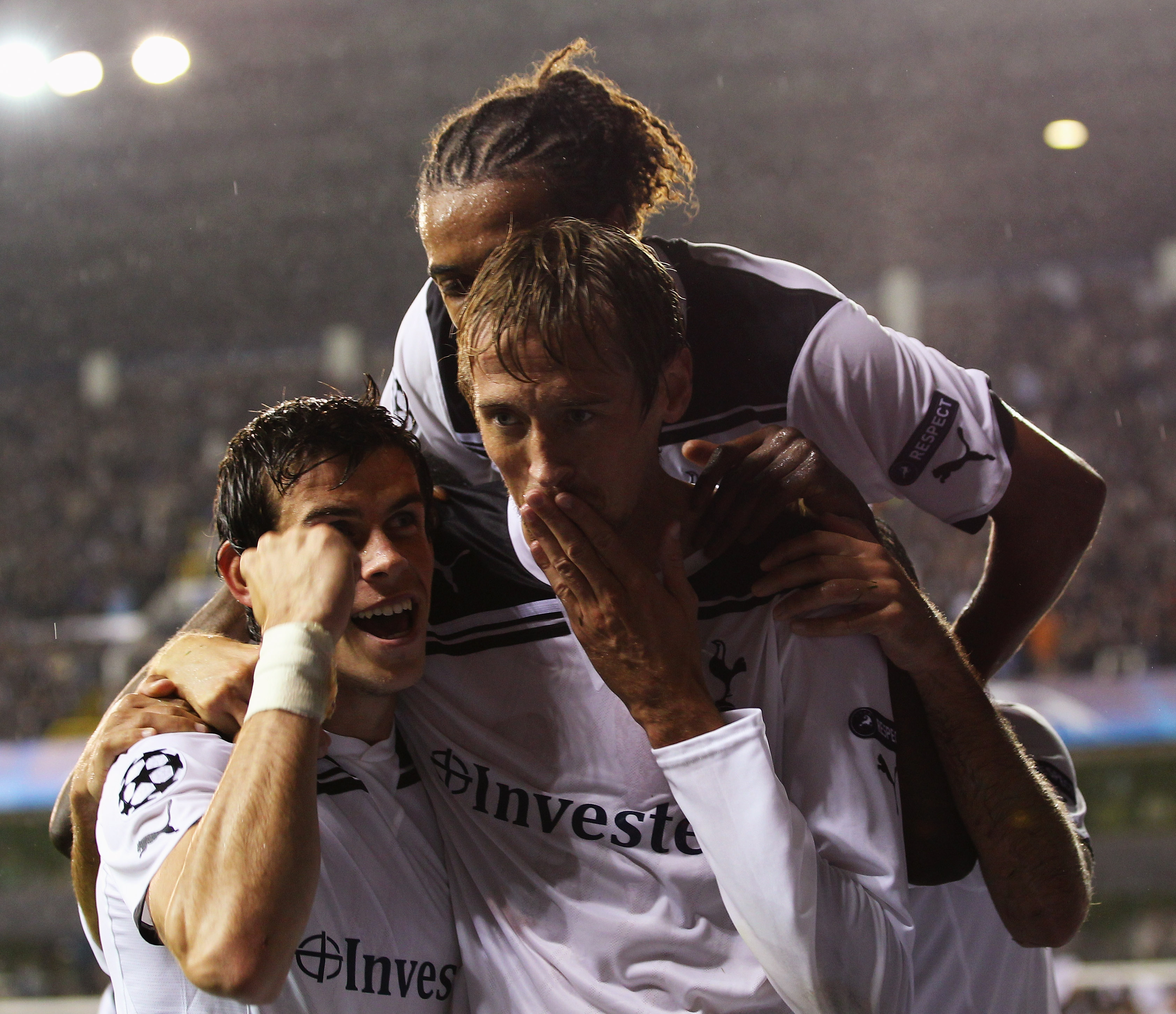 LONDON, ENGLAND - AUGUST 25:  Peter Crouch of Tottenham Hotspur celebrates with team mates as he scores their thrid goal during the UEFA Champions League play-off second leg match between Tottenham Hotspur and BSC Young Boys at White Hart Lane on August 2