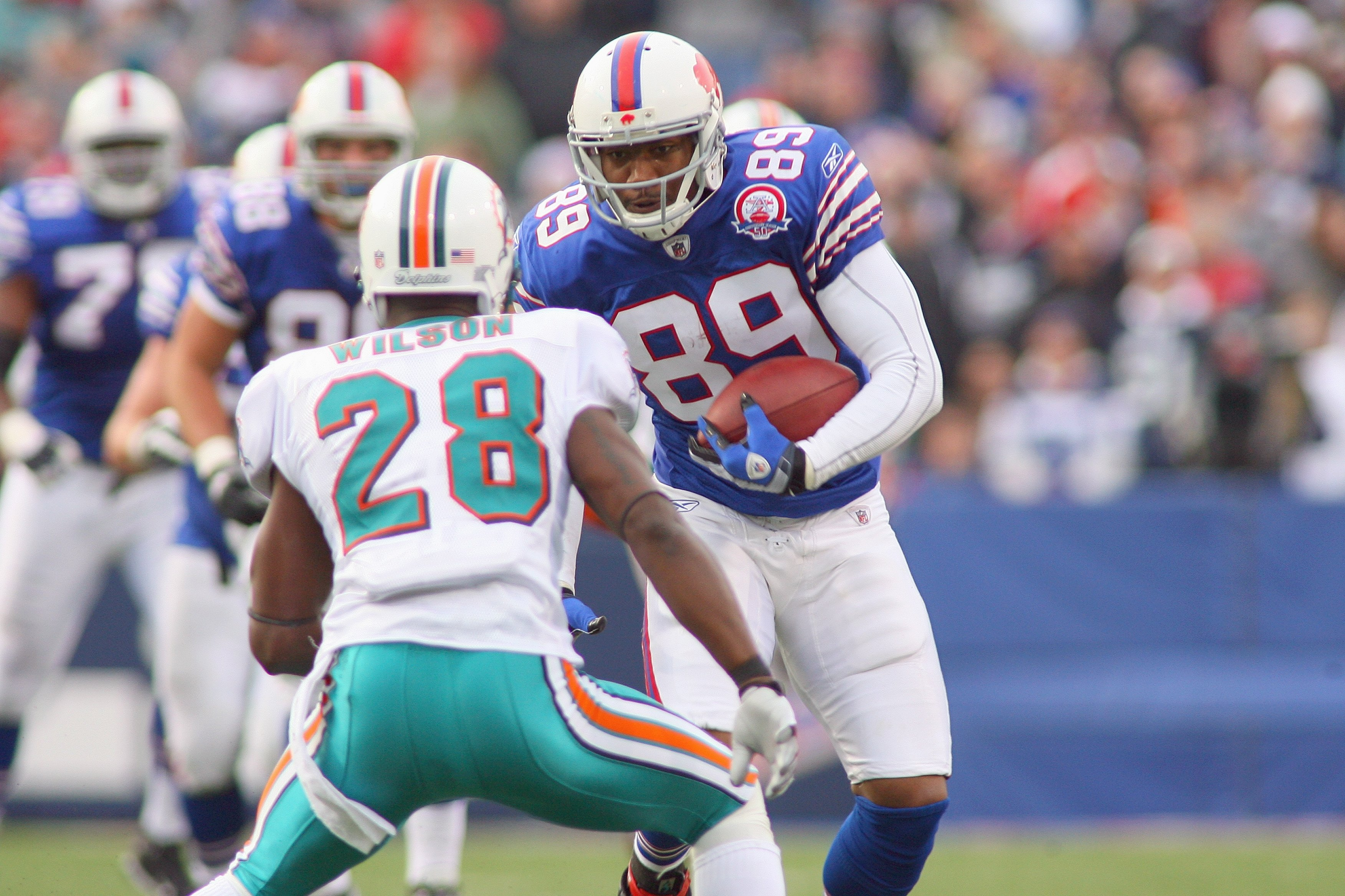 ORCHARD PARK, NY - NOVEMBER 29:  Shawn Nelson #89 of the Buffalo Bills carries the ball against Gibril Wilson #28 of the Miami Dolphins at Ralph Wilson Stadium on November 29, 2009 in Orchard Park, New York. Buffalo won 31-14. (Photo by Rick Stewart/Getty