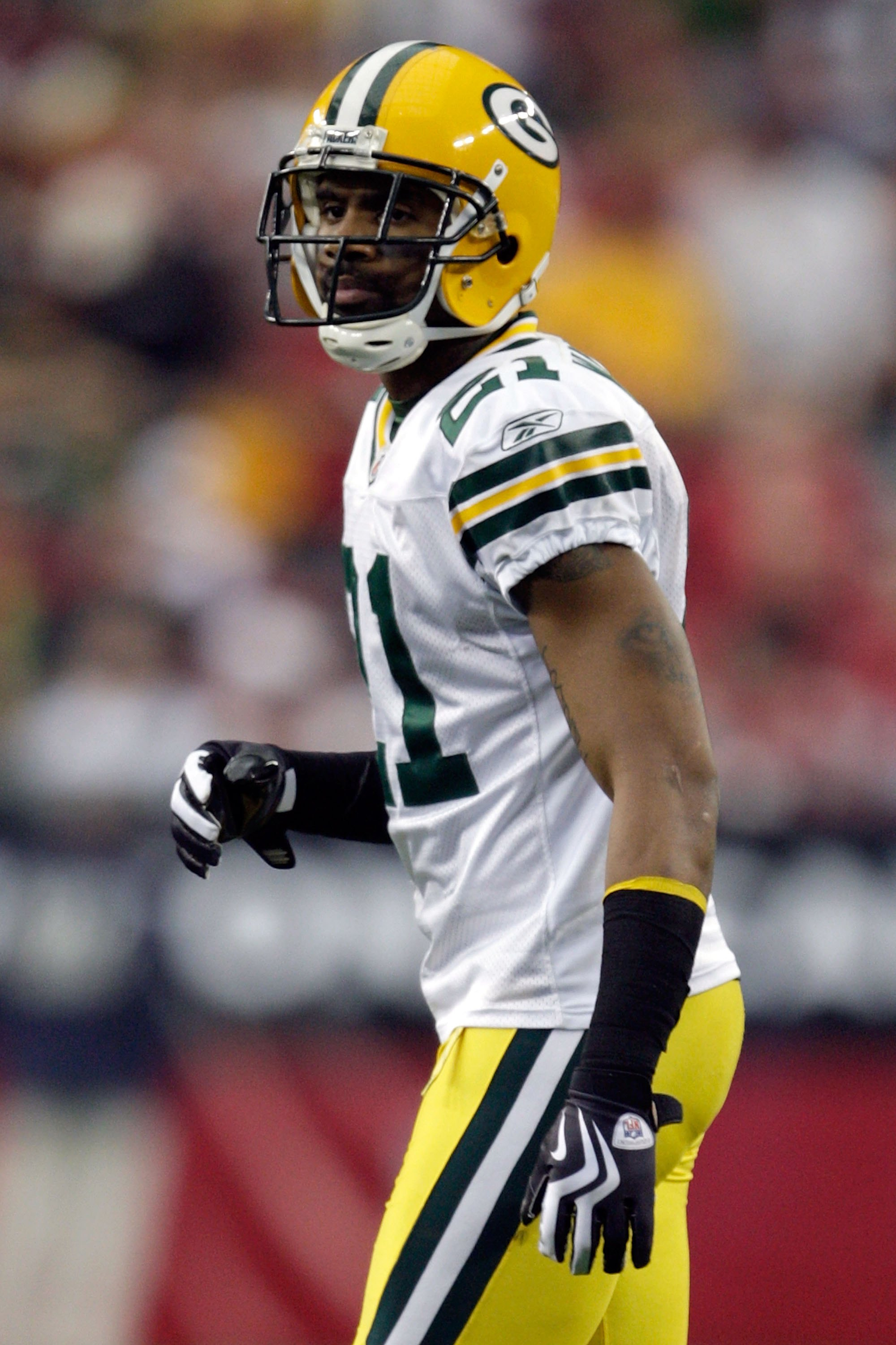 GLENDALE, AZ - JANUARY 03:  Charles Woodson #21 of the Green Bay Packers looks on from the field against the Arizona Cardinals in the second quarter at University of Phoenix Stadium on January 3, 2010 in Glendale, Arizona.  (Photo by Jamie Squire/Getty Im