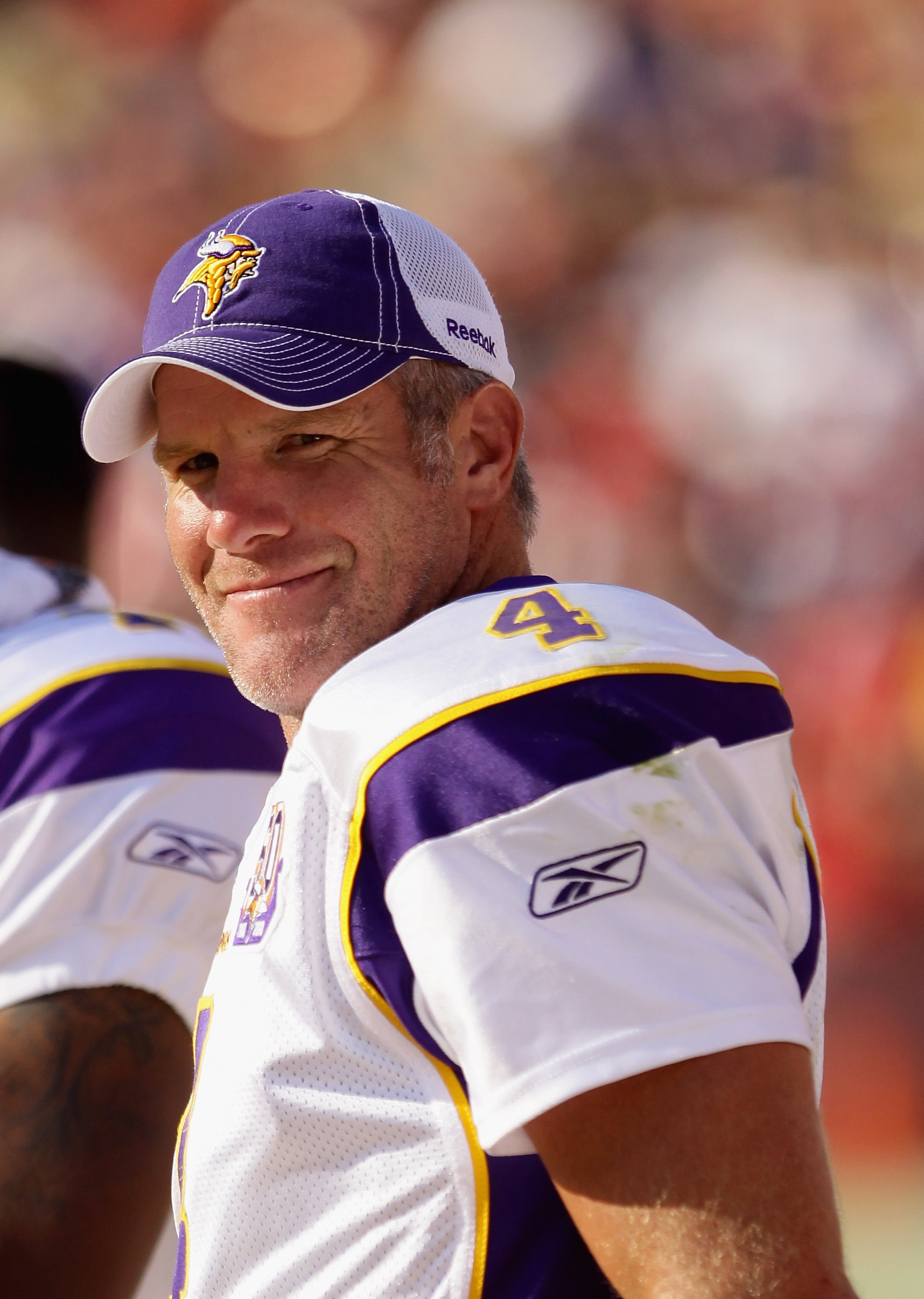 SAN FRANCISCO - AUGUST 22:  Brett Favre #4 of the Minnesota Vikings stands on the sidelines during their preseason game against the San Francisco 49ers at Candlestick Park on August 22, 2010 in San Francisco, California.  (Photo by Ezra Shaw/Getty Images)