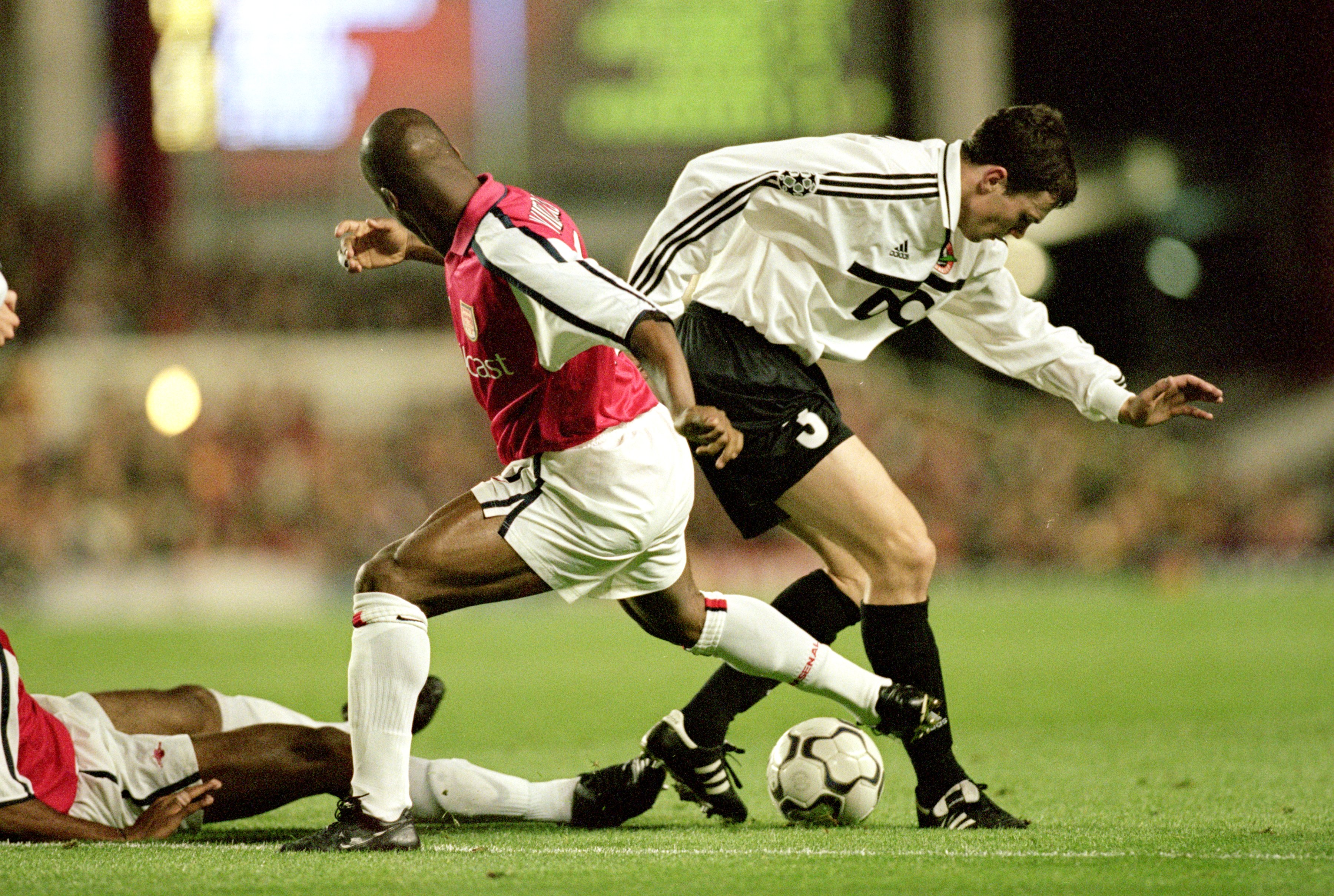 20 Sep 2000:  Dainius Gleveckas (#3) of Shakhtar Donetsk is challenged by Sylvain Wiltord of Arsenal during the UEFA Champions League match at Highbury in London.  Arsenal won the match 3-2. \ Mandatory Credit: Dave Cannon /Allsport