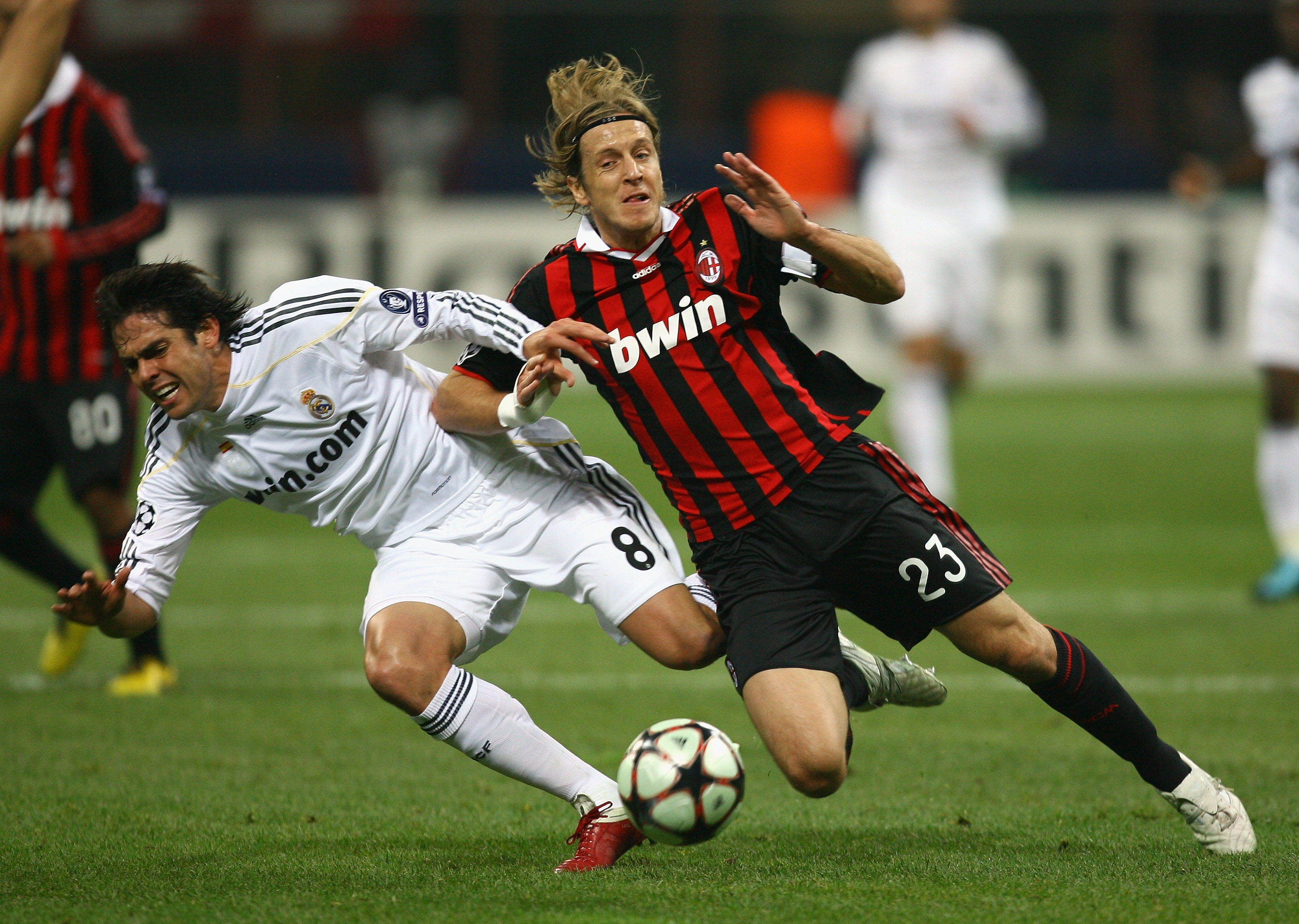 MILAN, ITALY - NOVEMBER 03:  Kaka of Real Madrid is tackled by Massimo Ambrosini of AC Milan during the UEFA Champions League Group C match between AC Milan and Real Madrid at the San Siro on November 3, 2009 in Milan, Italy.  (Photo by Alex Livesey/Getty