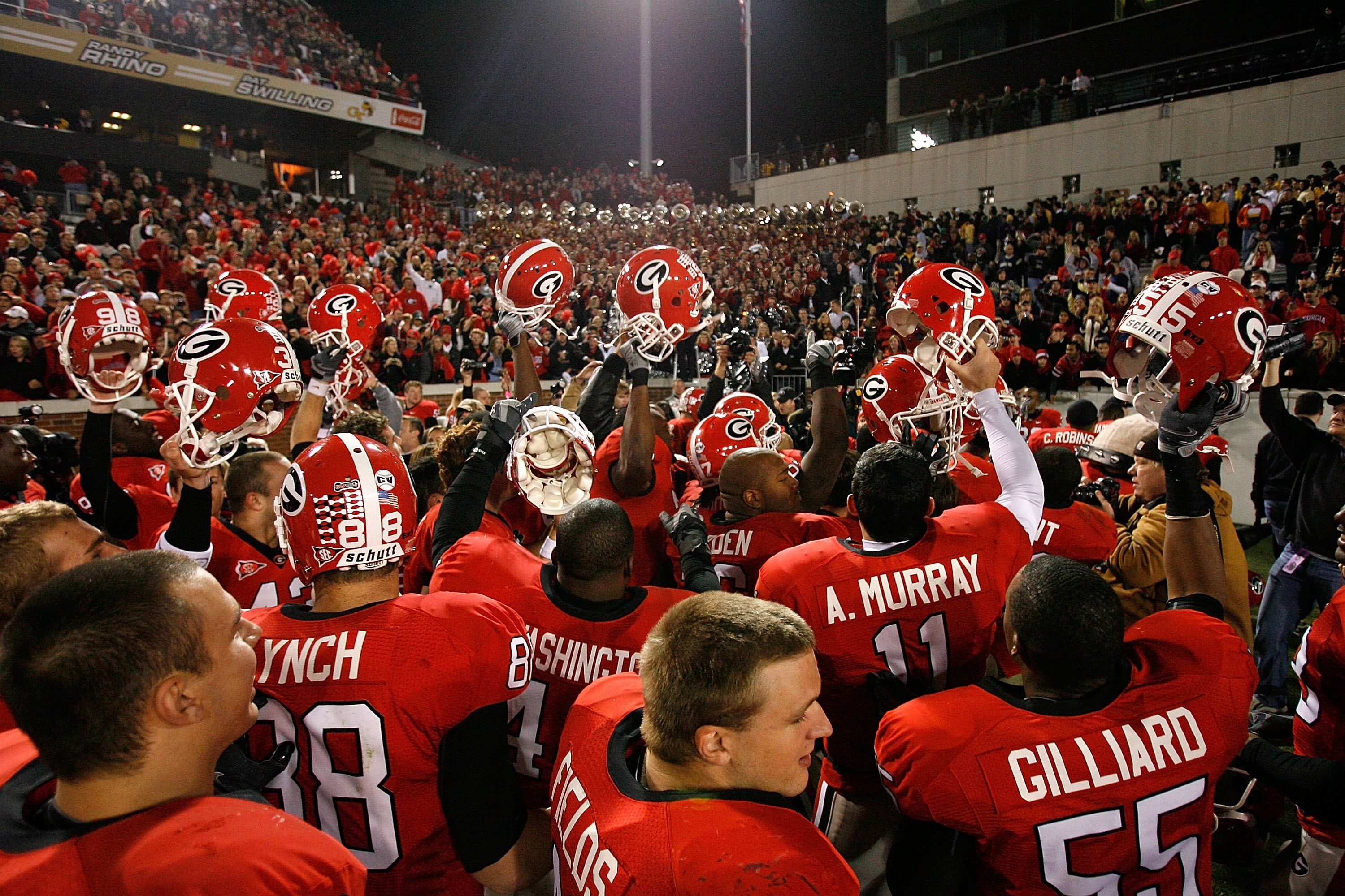 ATLANTA - NOVEMBER 28:  The Georgia Bulldogs celebrate their 30-24 win over the Georgia Tech Yellow Jackets at Bobby Dodd Stadium on November 28, 2009 in Atlanta, Georgia.  (Photo by Kevin C. Cox/Getty Images)