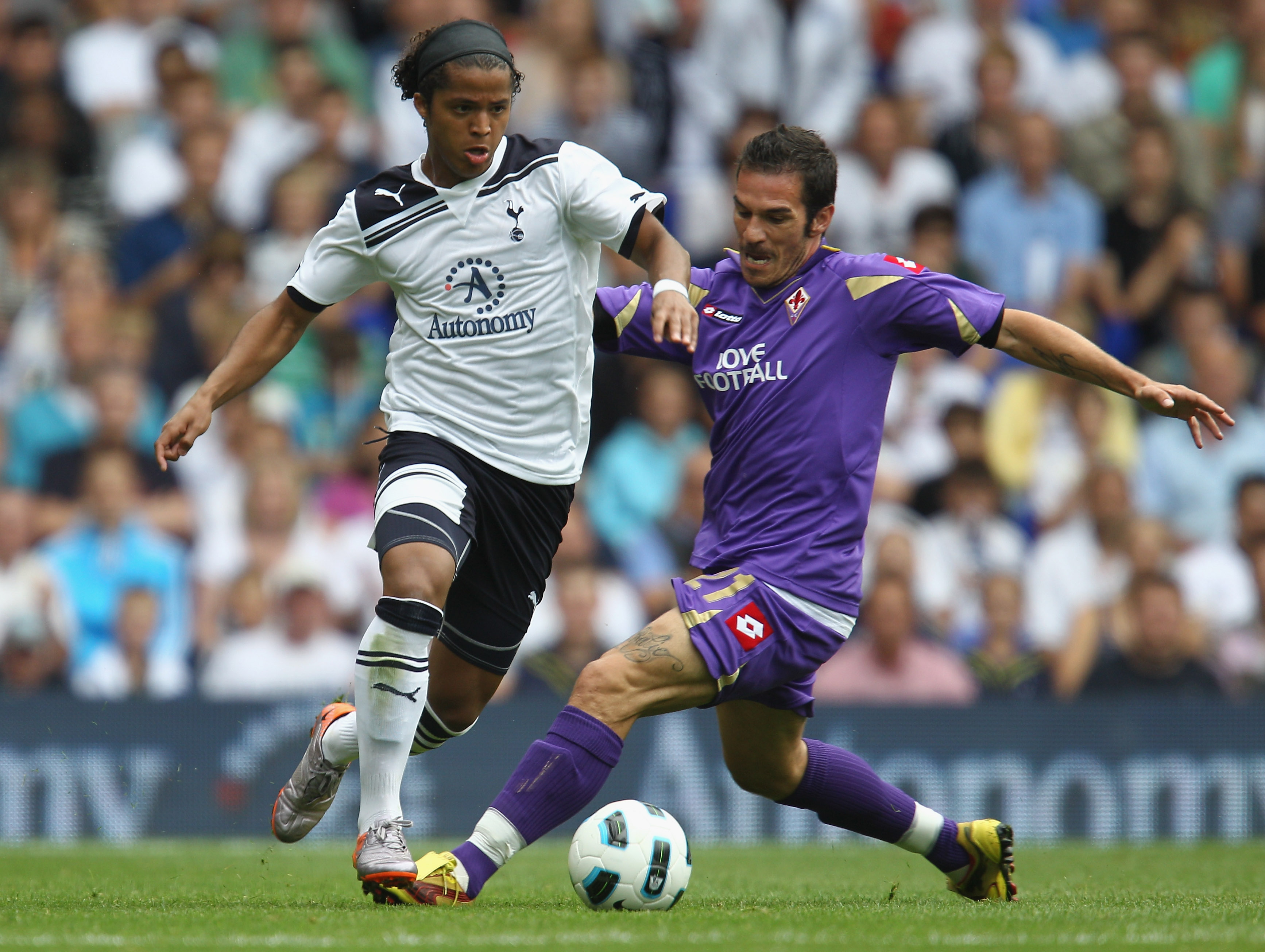 LONDON, ENGLAND - AUGUST 07:  Giovani Dos Santos of Tottenham Hotspur battles for the ball with Gaetano D'Agostino of Fiorentina during the pre-season friendly match between Tottenham Hotspur and Fiorentina at White Hart Lane on August 7, 2010 in London,