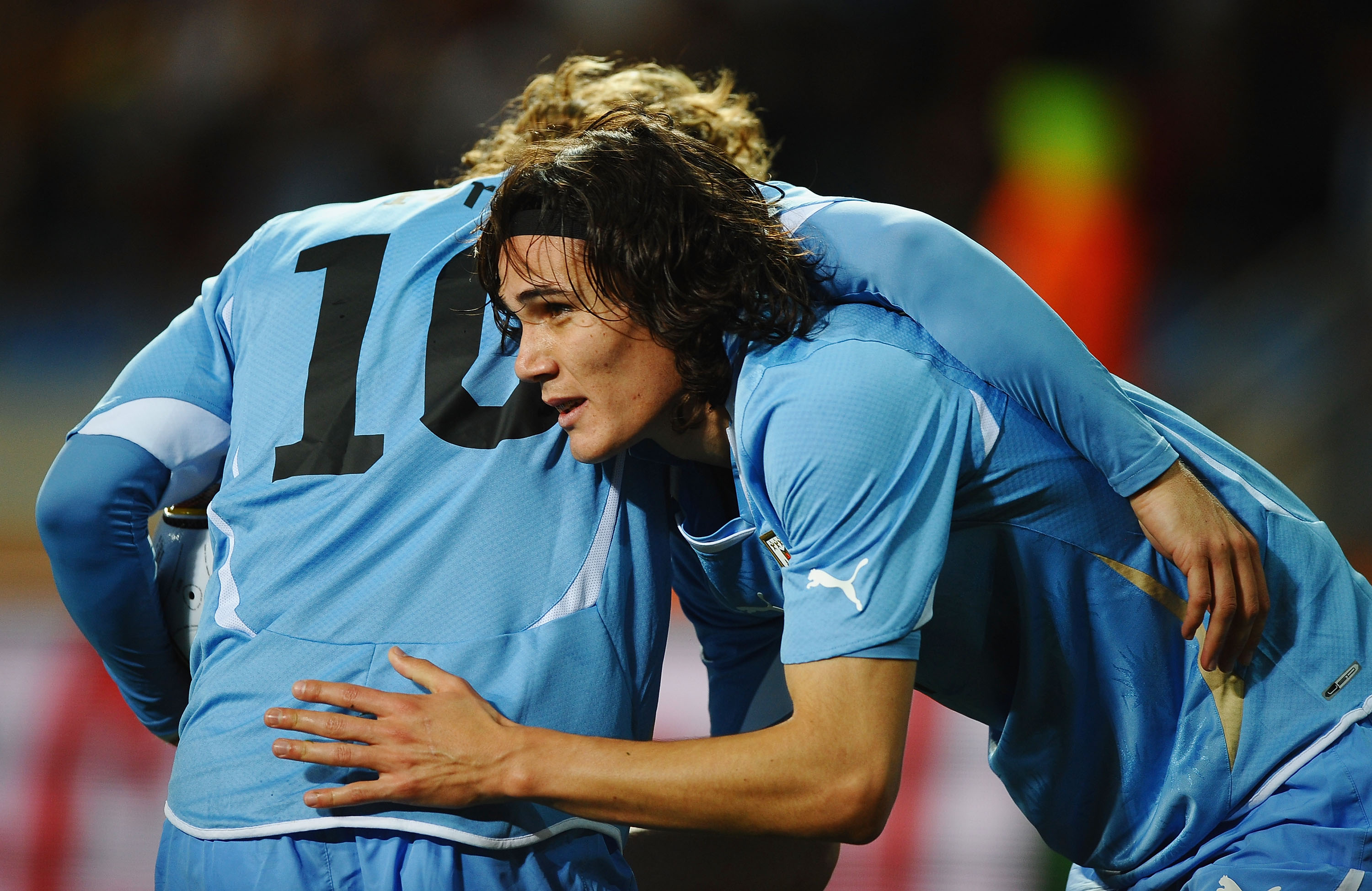 PORT ELIZABETH, SOUTH AFRICA - JULY 10:  Edinson Cavani of Uruguay (R) celebrates with Diego Forlan as he scores their first goal during the 2010 FIFA World Cup South Africa Third Place Play-off match between Uruguay and Germany at The Nelson Mandela Bay