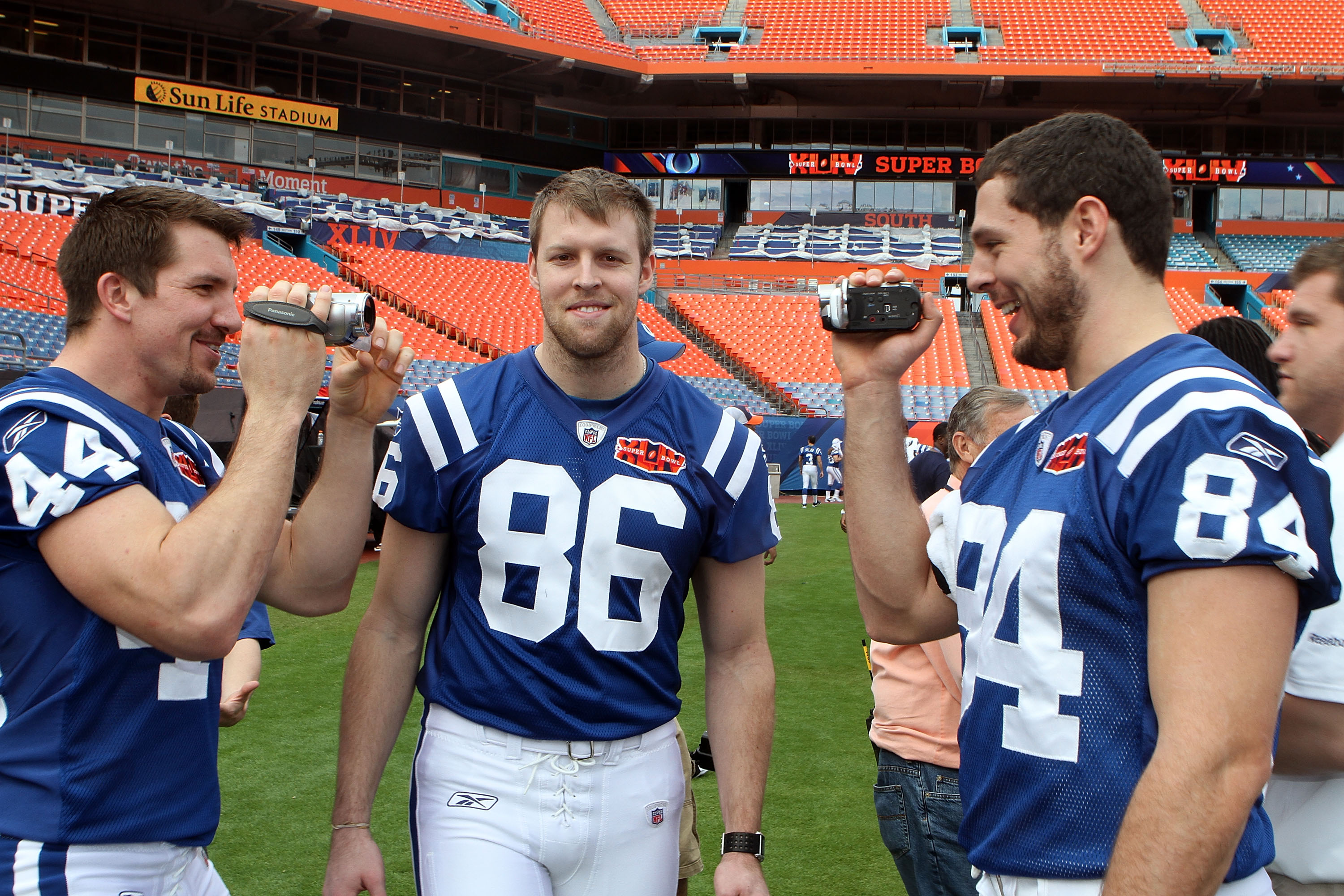 MIAMI GARDENS, FL - FEBRUARY 02:  Dallas Clark #44 of the Indianapolis Colts films teammate Jacob Tamme #84 as Tom Santi looks on during Super Bowl XLIV Media Day at Sun Life Stadium on February 2, 2010 in Miami Gardens, Florida.  (Photo by Doug Benc/Gett