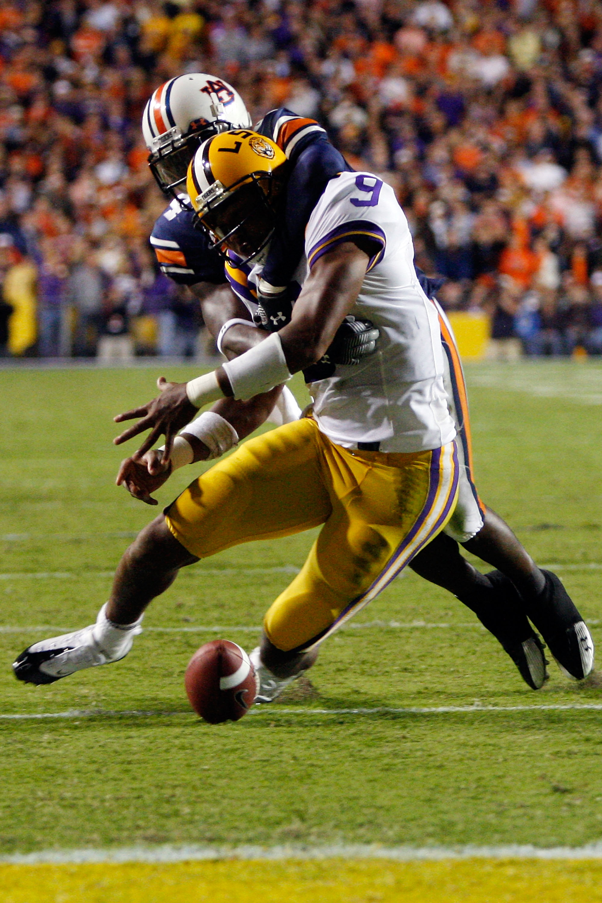 BATON ROUGE, LA - OCTOBER 24:  Jordan Jefferson #9 of the Louisiana State University Tigers is stripped of the ball by Zac Etheridge #4 of the Auburn Tigers at Tiger Stadium on October 24, 2009 in Baton Rouge, Louisiana.  (Photo by Chris Graythen/Getty Im