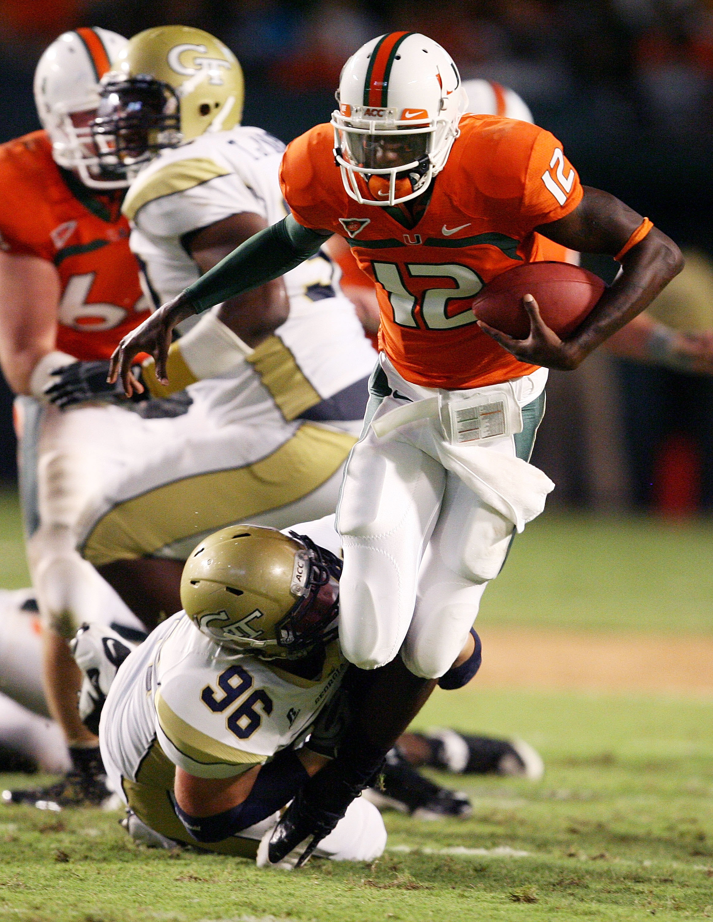 FORT LAUDERDALE, FL - SEPTEMBER 17:  Quarterback Jacory Harris #12 of the Miami Hurricanes is brought down by defensive tackle Logan Walls #96 of the Georgia Tech Yellow Jackets at Land Shark Stadium on September 17, 2009 in Fort Lauderdale, Florida. Miam