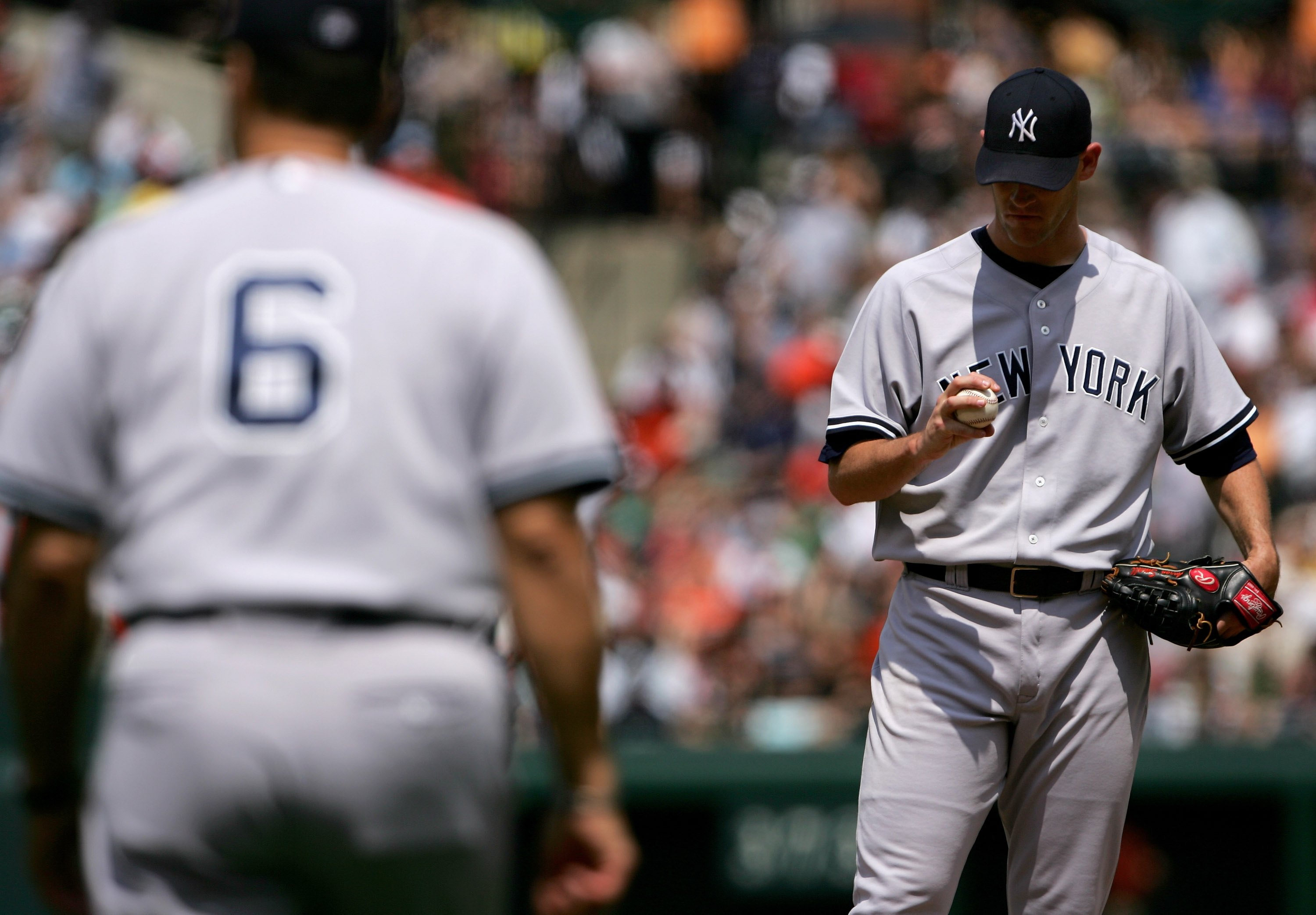 BALTIMORE - JUNE 04:  Starting pitcher Aaron Small #31 of the New York Yankees waits to be pulled by manager Joe Torre #6 in the third inning against the Baltimore Orioles at Oriole Park at Camden Yards on June 4, 2006 in Baltimore, Maryland. The Orioles