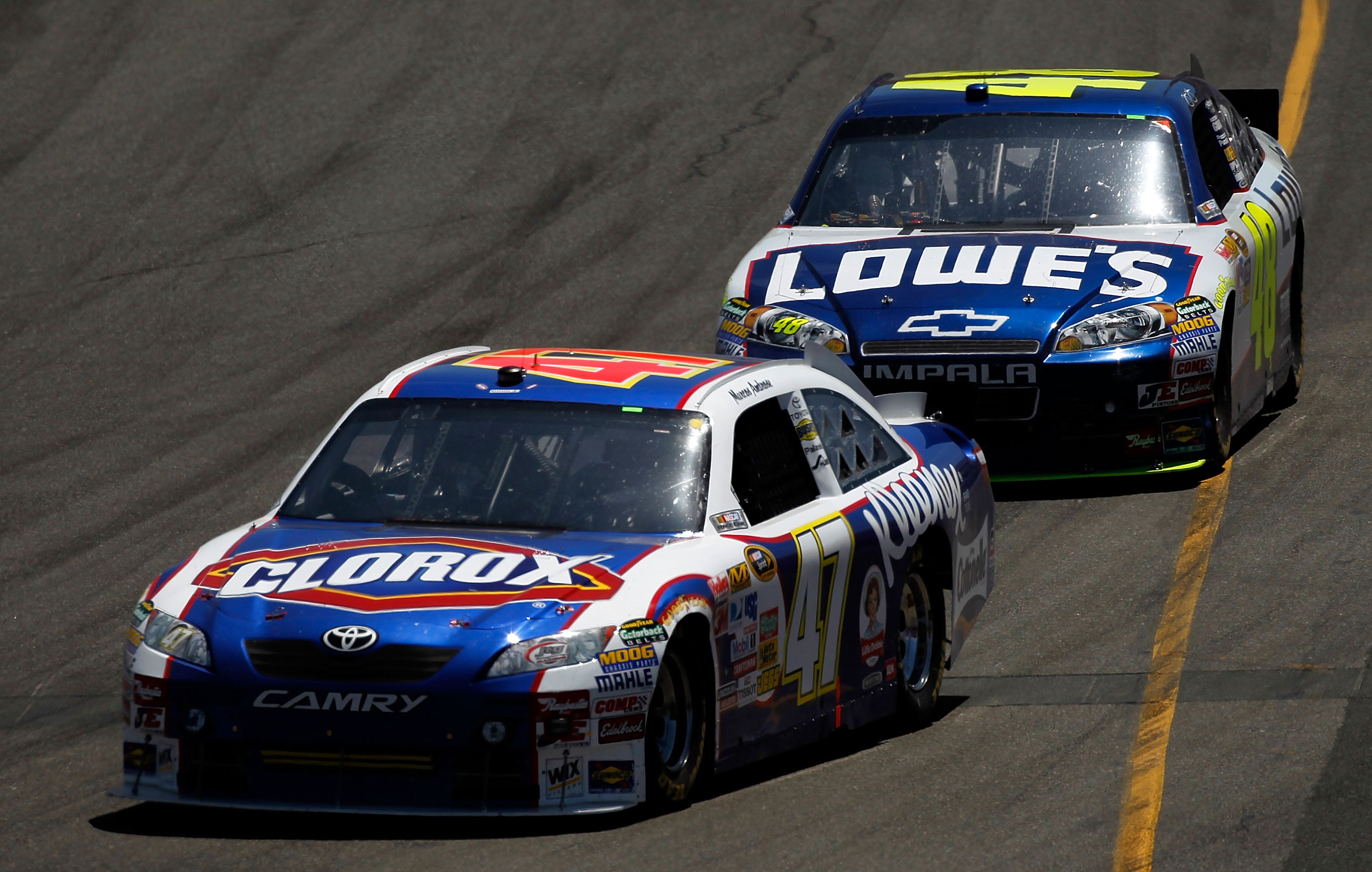 SONOMA, CA - JUNE 20:  Marcos Ambrose, driver of the #47 Clorox Toyota, leads Jimmie Johnson, driver of the #48 Lowe's Chevrolet, during the NASCAR Sprint Cup Series Toyota/Save Mart 350 at Infineon Raceway on June 20, 2010 in Sonoma, California.  (Photo