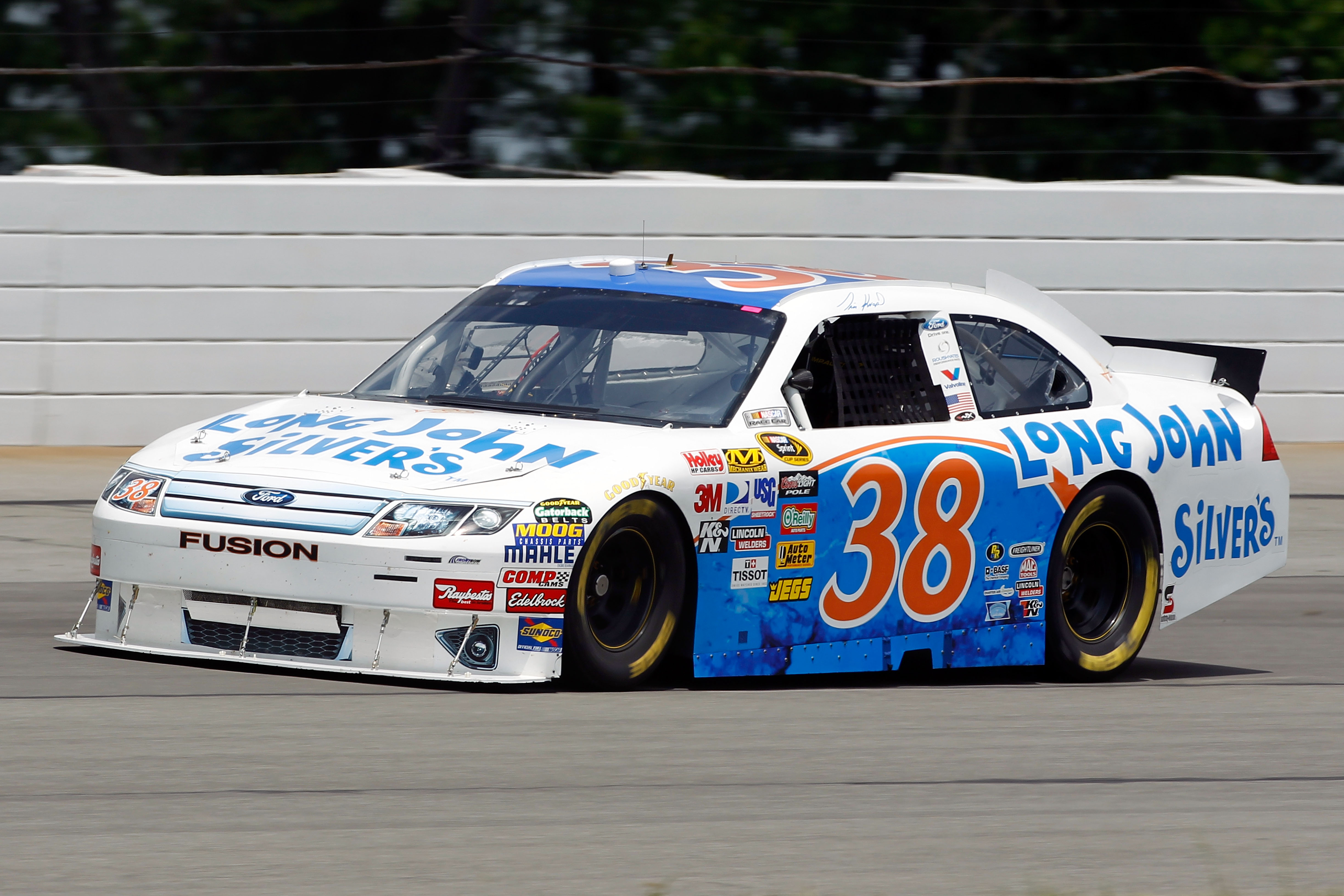 LONG POND, PA - JUNE 04:  Travis Kvapil drives the #38 Long John Silver's/Baja Fish Taco Ford during practice for the NASCAR Sprint Cup Series Gillette Fusion ProGlide 500 at Pocono Raceway on June 4, 2010 in Long Pond, Pennsylvania.  (Photo by Chris Trot