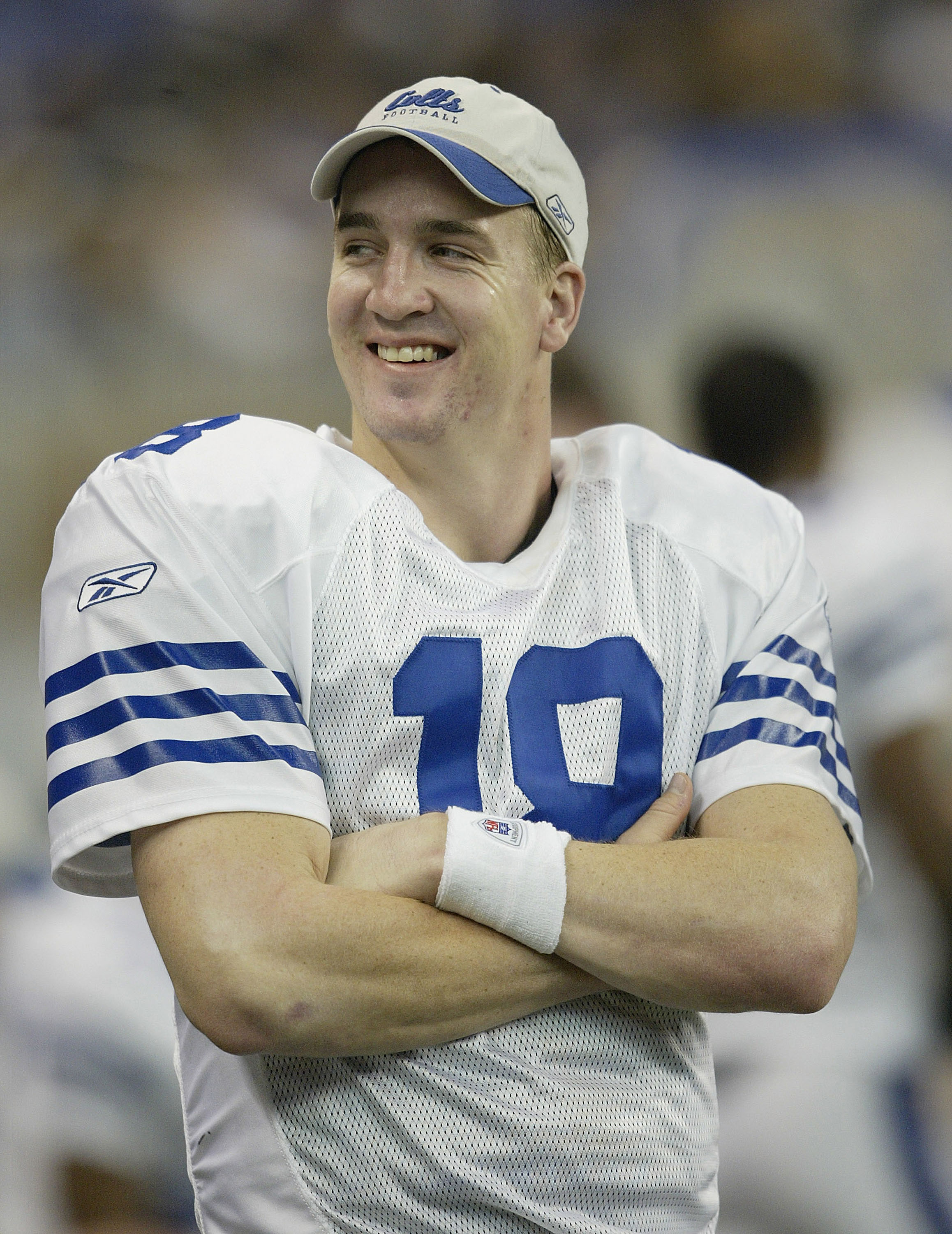 DETROIT, MI - NOVEMBER 25:  Peyton Manning #18 of the Indianapolis Colts smiles on the sidelines in the third quarter against the Detroit Lions at Ford Field on November 25, 2004 in Detroit, Michigan. (Photo by Tom Pidgeon/Getty Images)