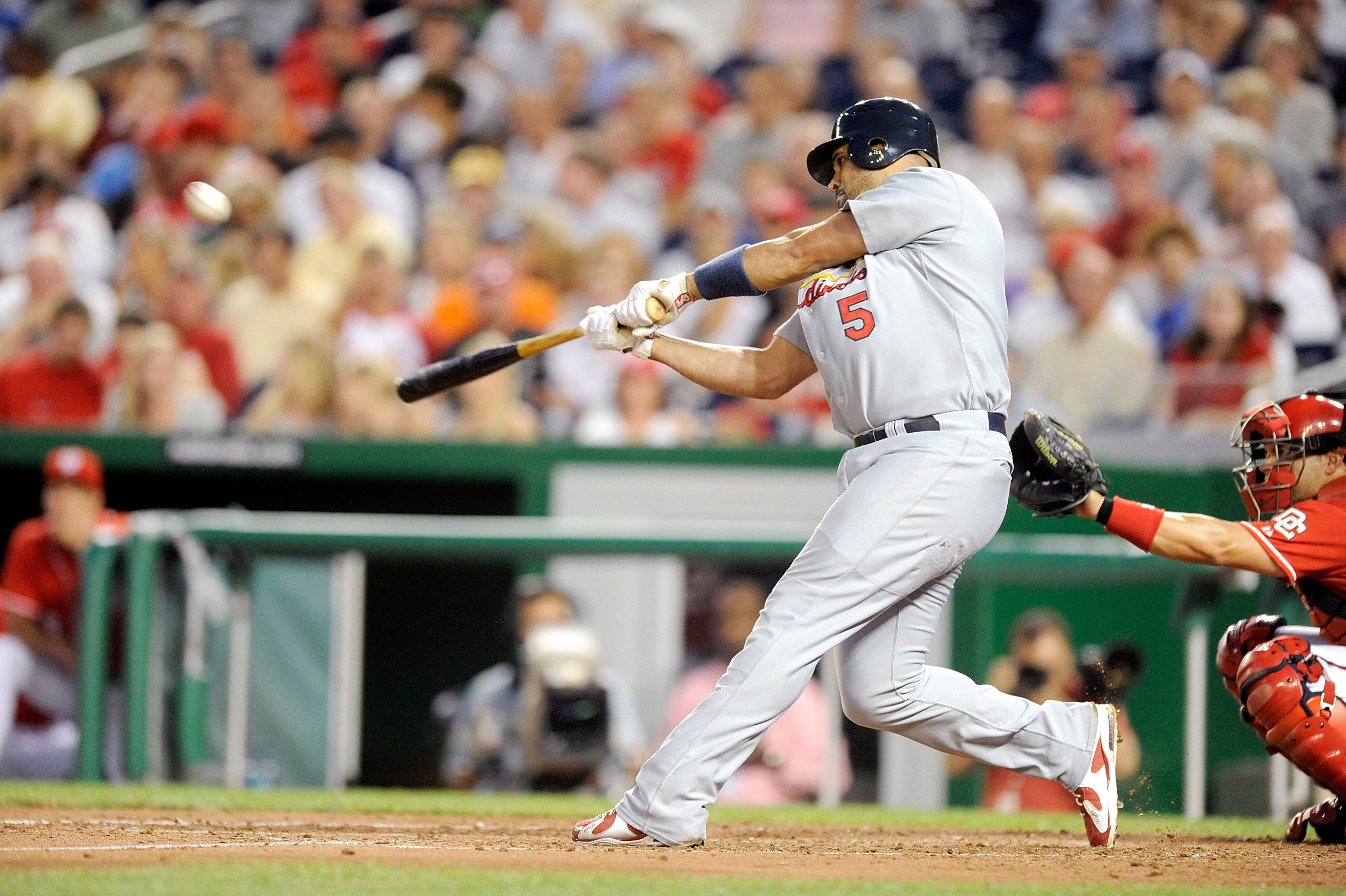 WASHINGTON - AUGUST 26:  Albert Pujols #5 of the St. Louis Cardinals hits a home run in the fourth inning against the Washington Nationals at Nationals Park on August 26, 2010 in Washington, DC. It was the 400th home run of his career. (Photo by Greg Fium