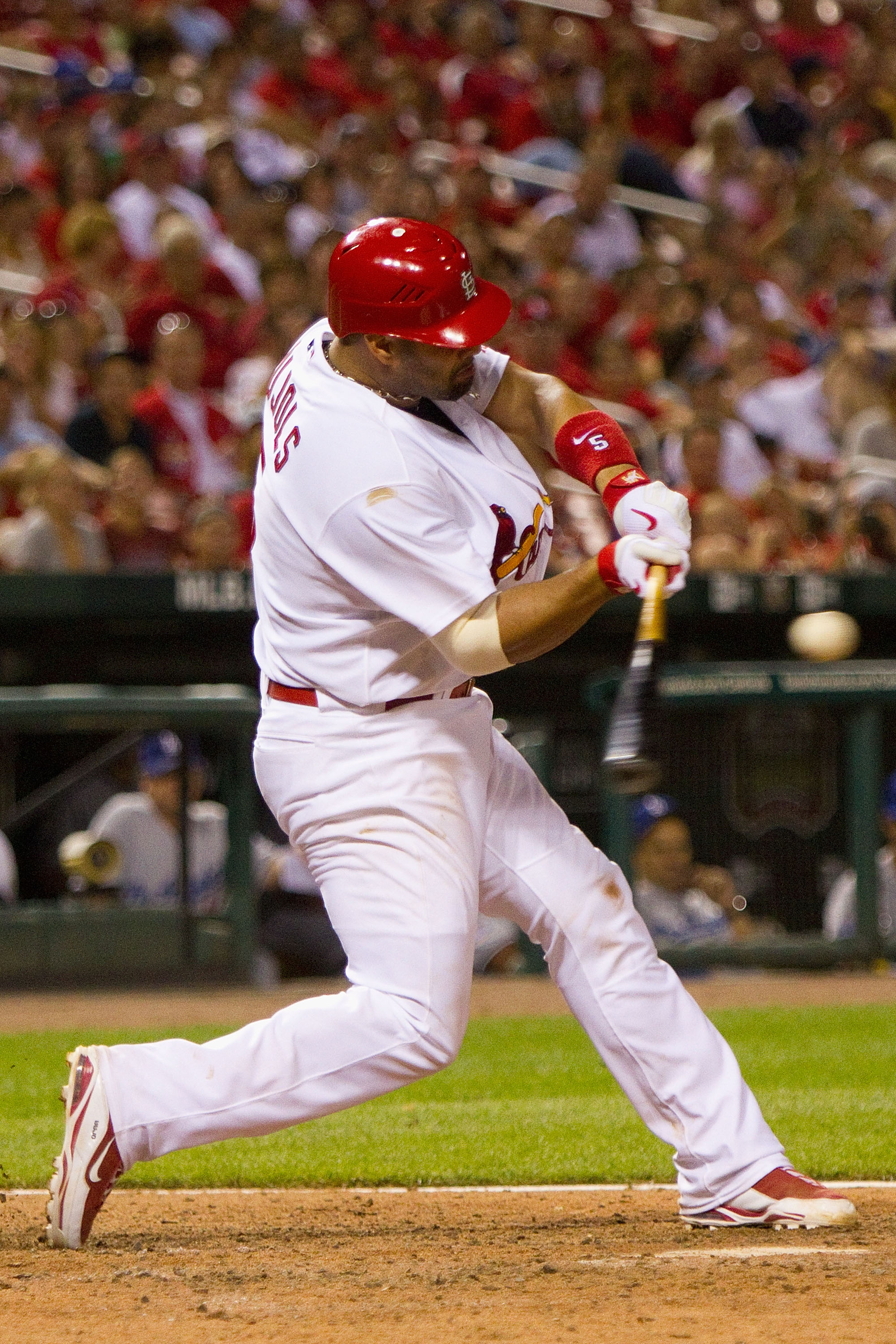 ST. LOUIS - JULY 15: Albert Pujols #5 of the St. Louis Cardinals collects a hit against the Los Angeles Dodgers at Busch Stadium on July 15, 2010 in St. Louis, Missouri.  The Cardinals beat the Dodgers 7-1.  (Photo by Dilip Vishwanat/Getty Images)