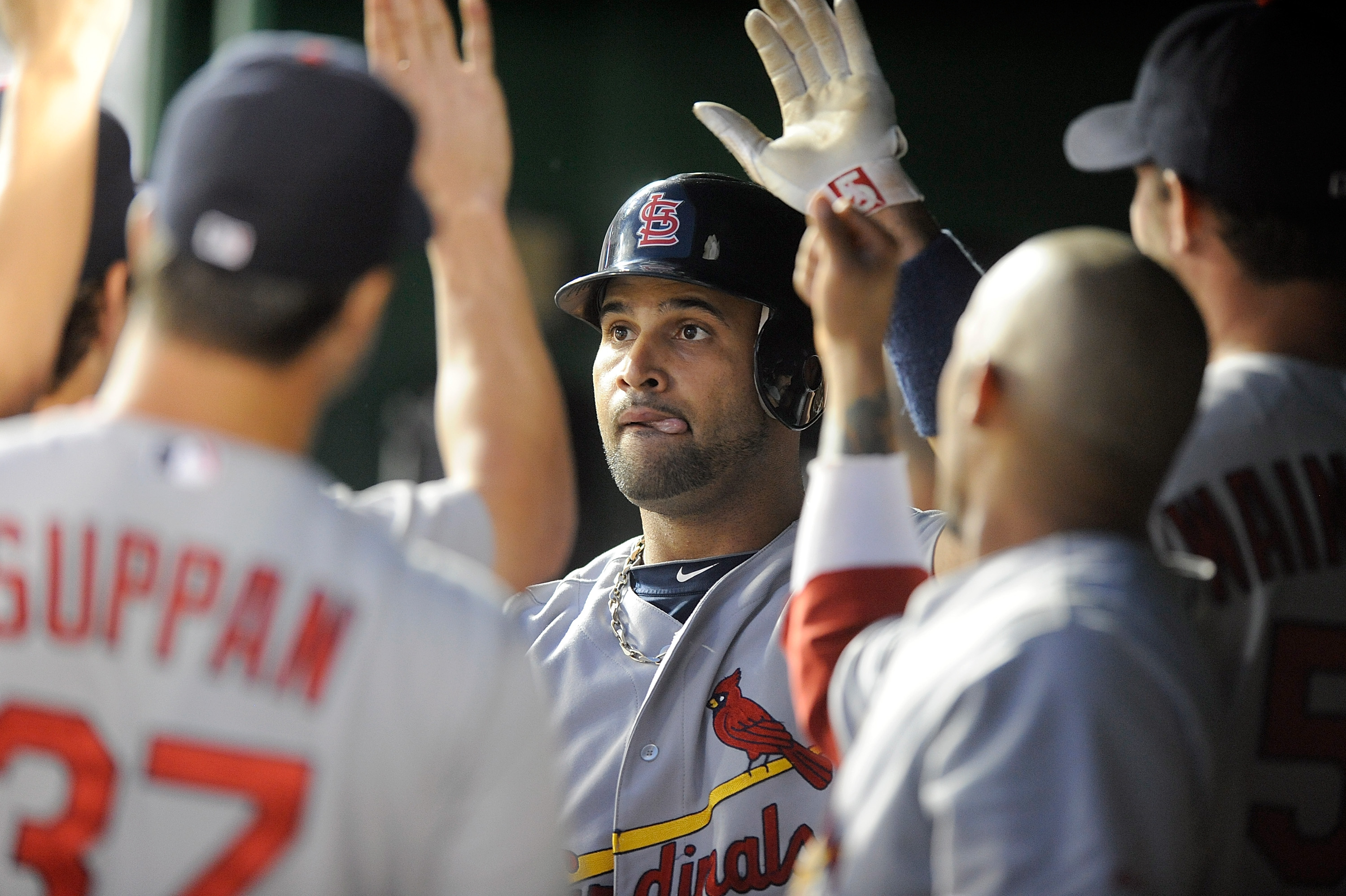 WASHINGTON - AUGUST 26:  Albert Pujols #5 of the St. Louis Cardinals is congratulated by teammates after hitting a home run in the fourth inning against the Washington Nationals at Nationals Park on August 26, 2010 in Washington, DC. It was the 400th home